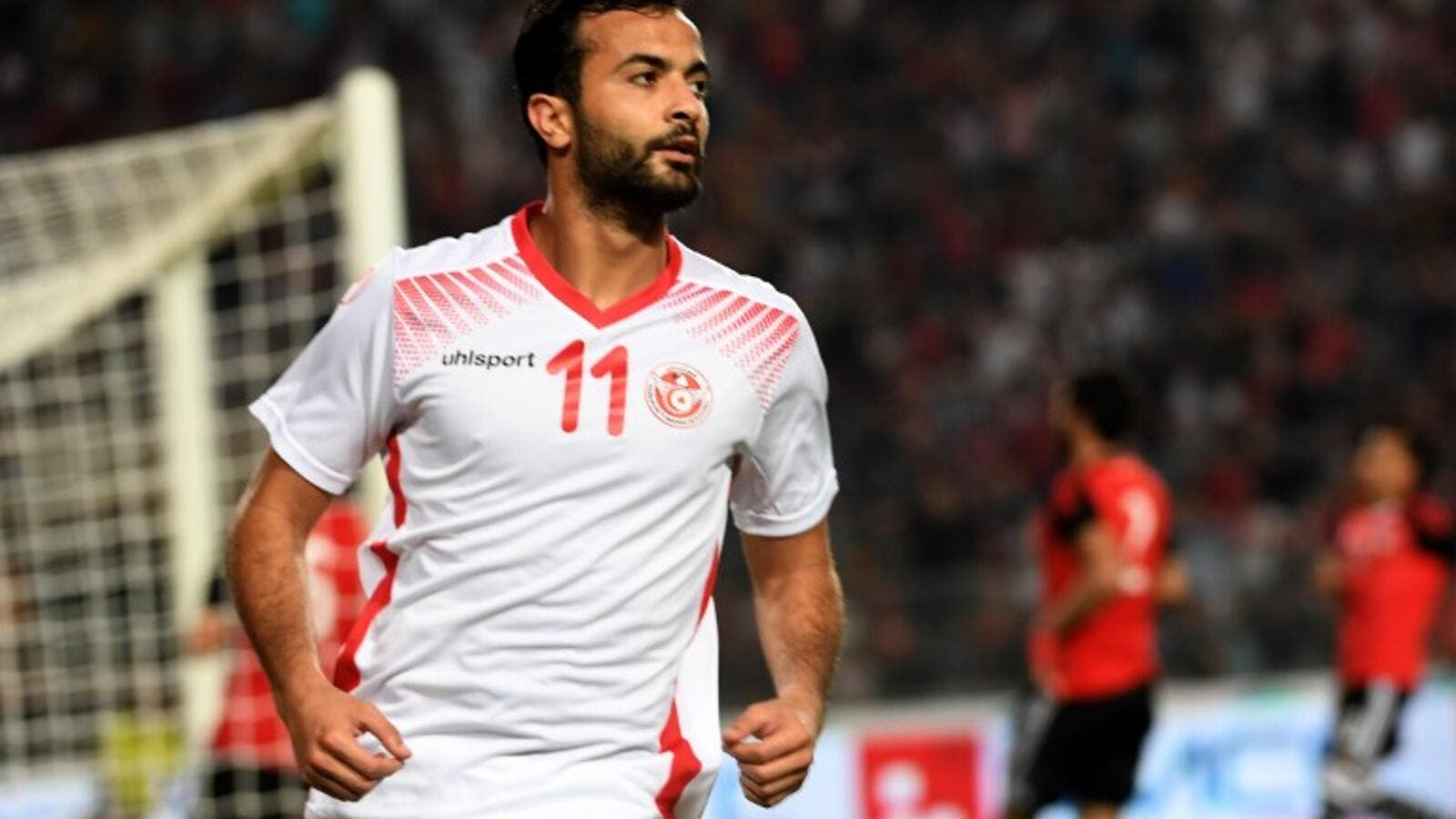 Tunisian striker Taha Yassine Khenissi celebrates after scoring against Egypt during their African Cup of Nations CAN 2019 preliminary stage qualification football match in Rades on June 11, 2017.