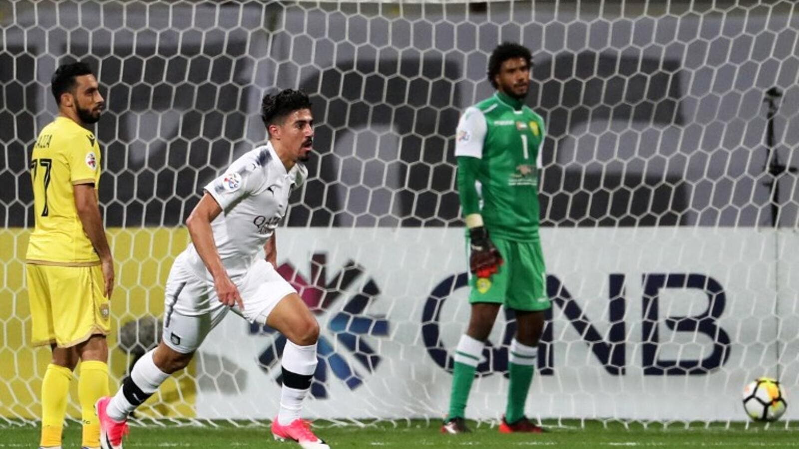 Qatar's al-Sadd player Baghdad Bounedjah (C) celebrates after scoring a goal during the AFC Champions League group stage football match between al-Wasl and al-Sadd at the Zabeel Stadium in Dubai on February 13, 2018.