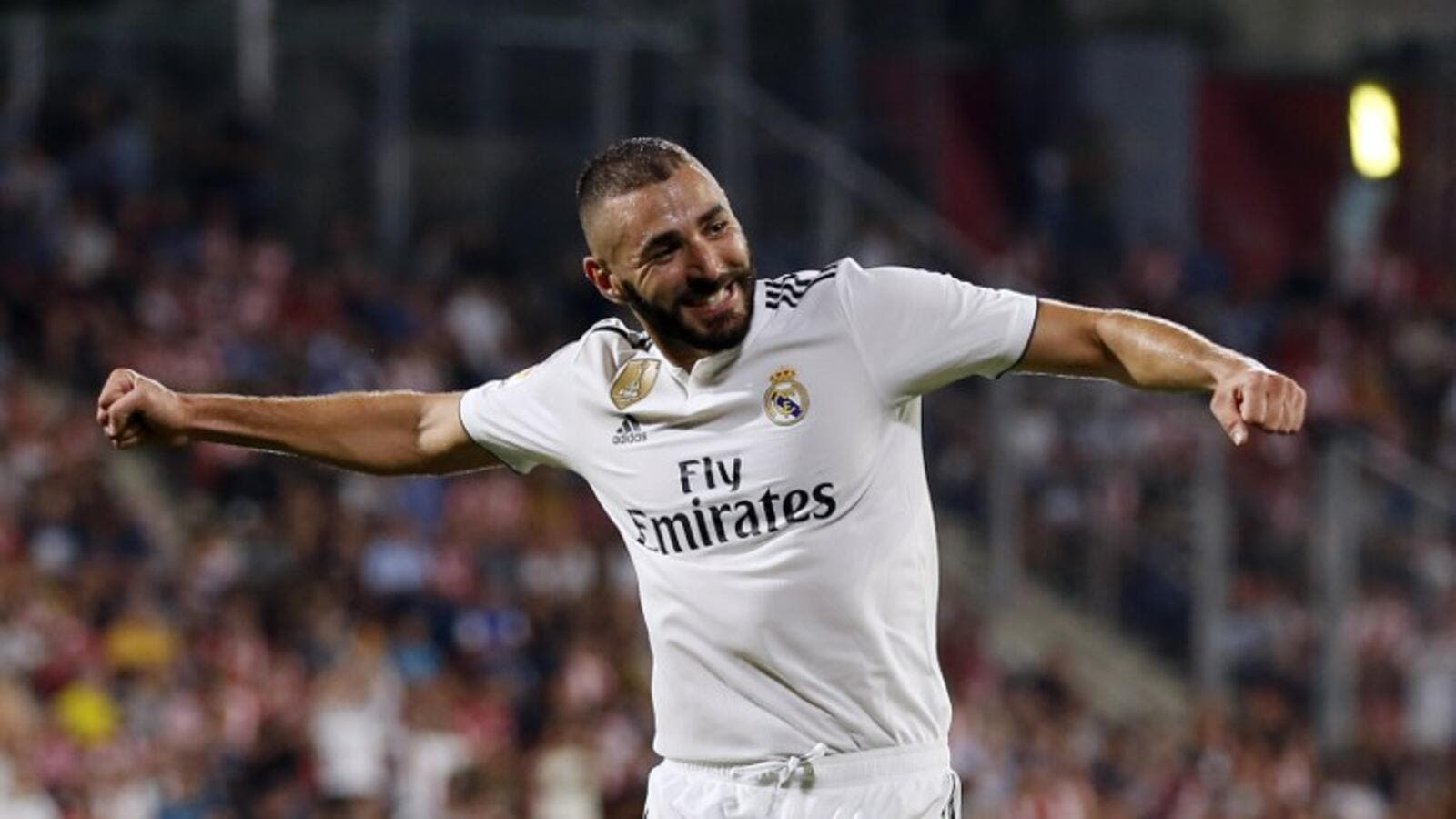 Real Madrid's French forward Karim Benzema celebrates his second goal during the Spanish league football match between Girona FC and Real Madrid CF at the Montilivi stadium in Girona on August 26, 2018.