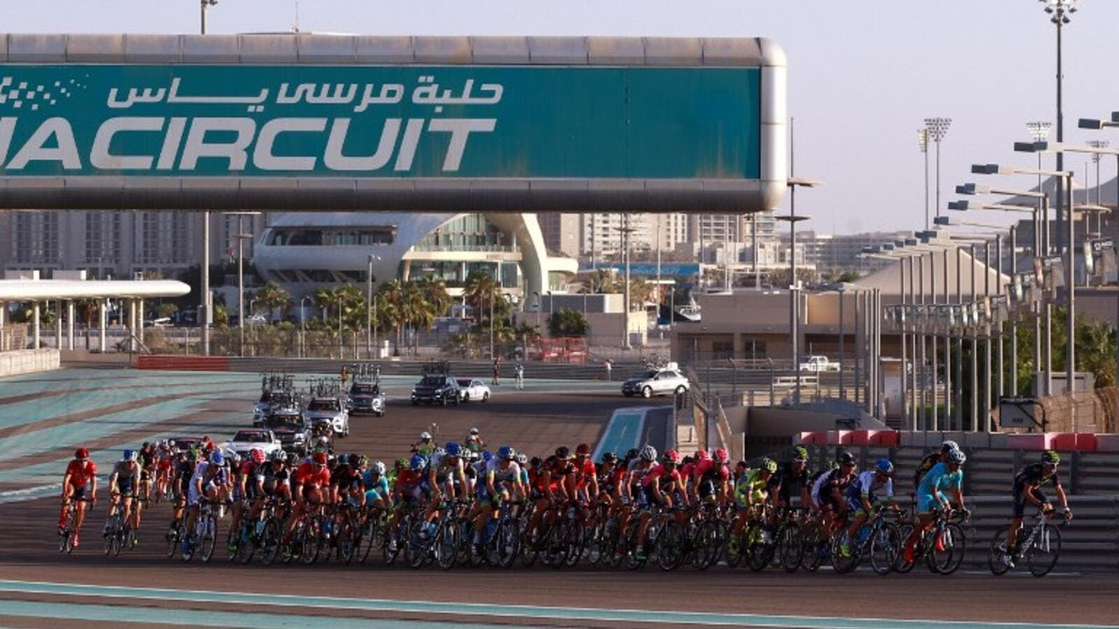 Cyclists ride their bikes during the Abu Dhabi tour from the Yas Marina Circuit to Yas Mall where the tour finishes in the Emirati capital Abu Dhabi, on October 11, 2015. AFP PHOTO / STR
