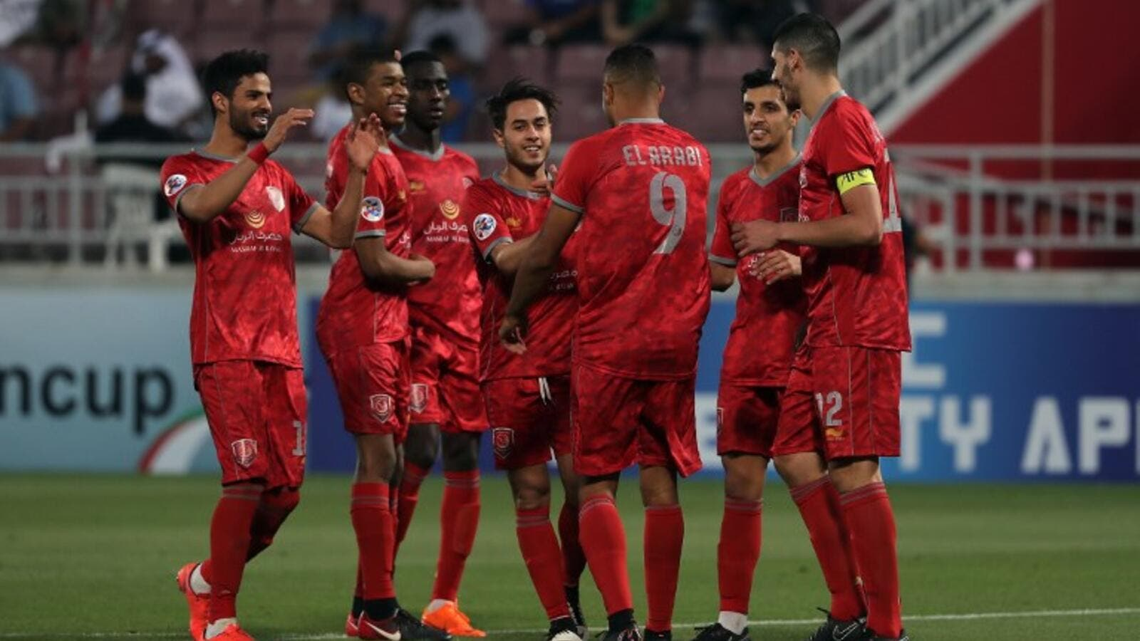 Duhail's players celebrate scoring during their AFC Champions League match between Qatar's Al-Duhail and Emirates' Al-Wahda at the Abdullah bin Khalifa Stadium in Doha on April 17, 2018.