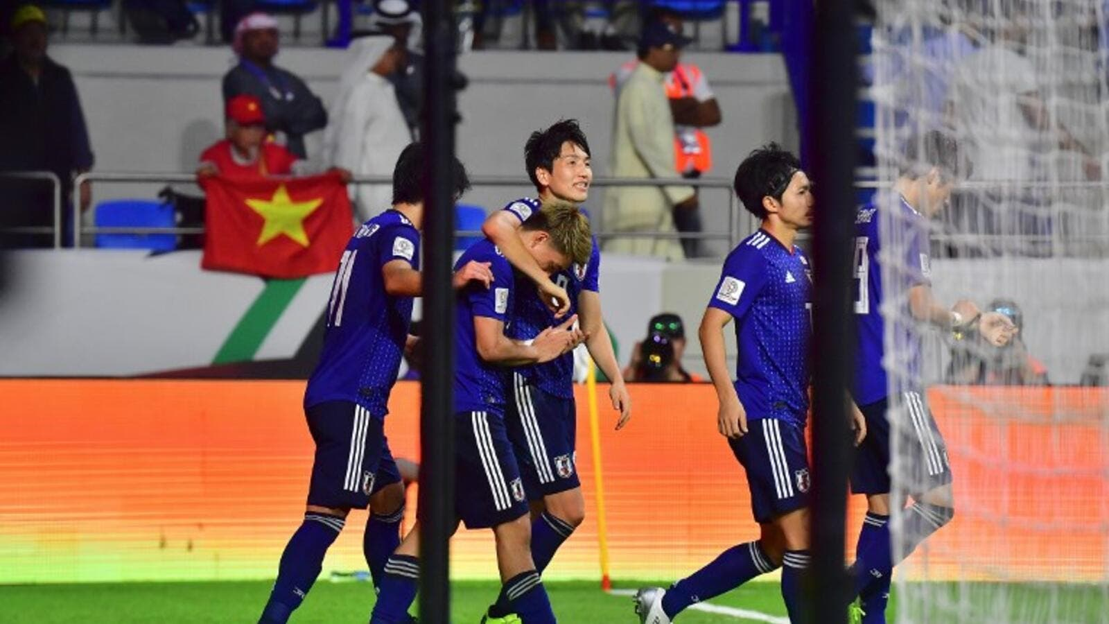 Japan's players celebrate their goal during the 2019 AFC Asian Cup quarter-final football match between Vietnam and Japan at the Al-Maktoum Stadium in Dubai on January 24, 2019.