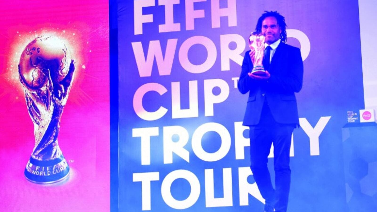 Retired French footballer Christian Karembeu holds the FIFA World Cup Trophy during a ceremony in Lahore on February 3, 2018. The FIFA World Cup Trophy Tour is heading to 50 countries across six continents before returning to the host country in May, ahead of the 2018 FIFA World Cup in Russia.