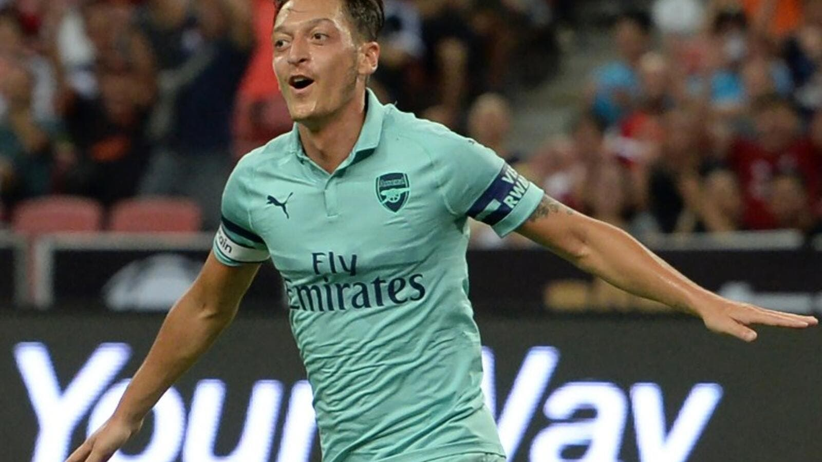 Mesut Ozil of Arsenal celebrates after scoring during the International Champions Cup football match between Arsenal and Paris Saint-Germain in Singapore on July 28, 2018.