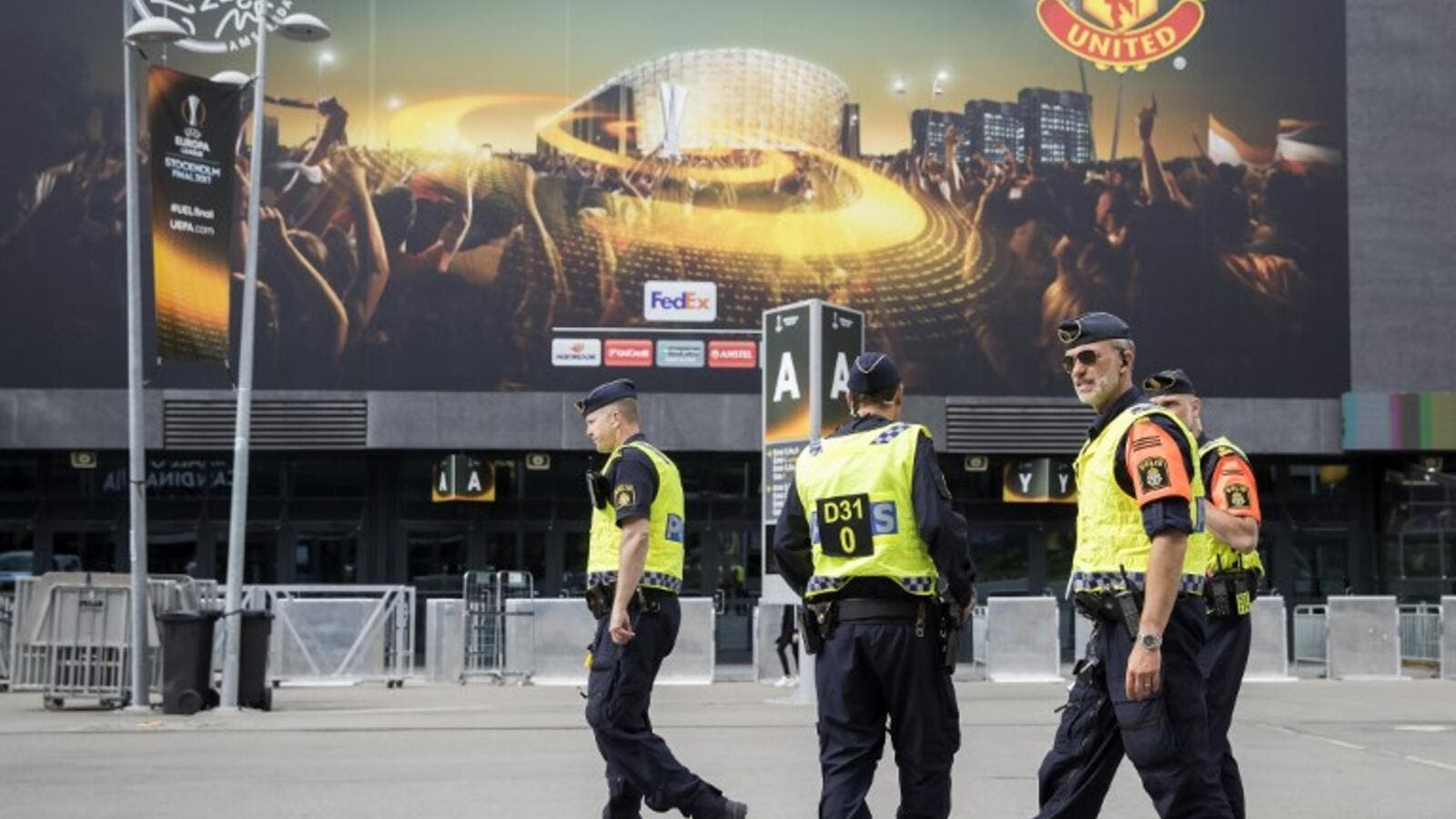 Police patrol outside the Friends arena in Stockholm on May 23, 2017, on the eve of the UEFA Europa League football final between Ajax and Manchester United.