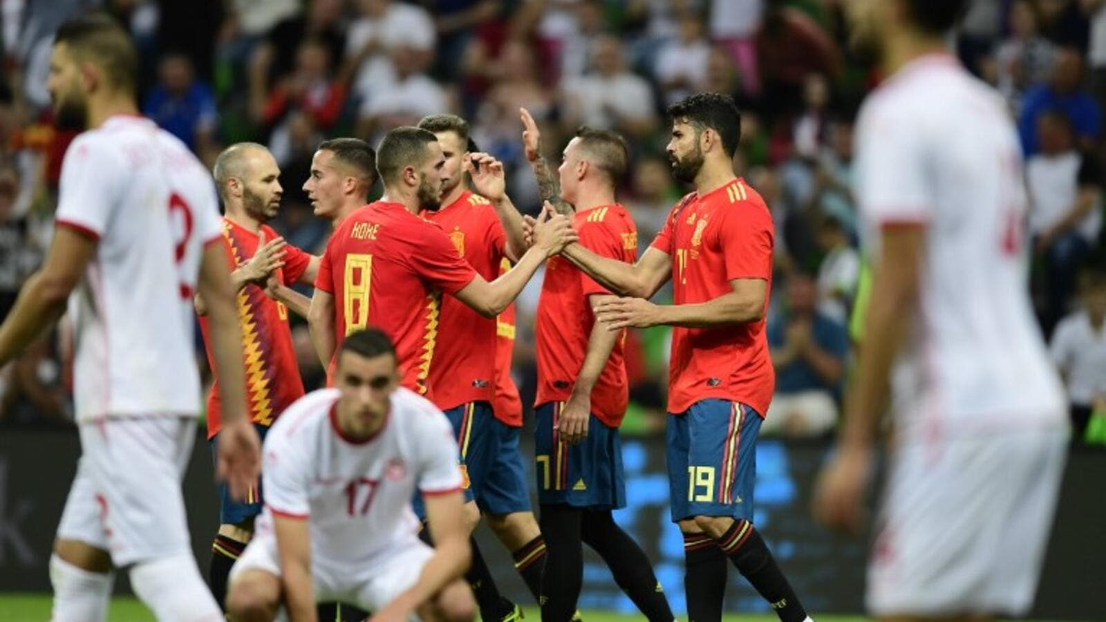 Spain's forward Iago Aspas (2nd R) celebrates with team mates after scoring a goal during the friendly football match between Spain and Tunisia at Krasnodar's stadium on June 9, 2018.