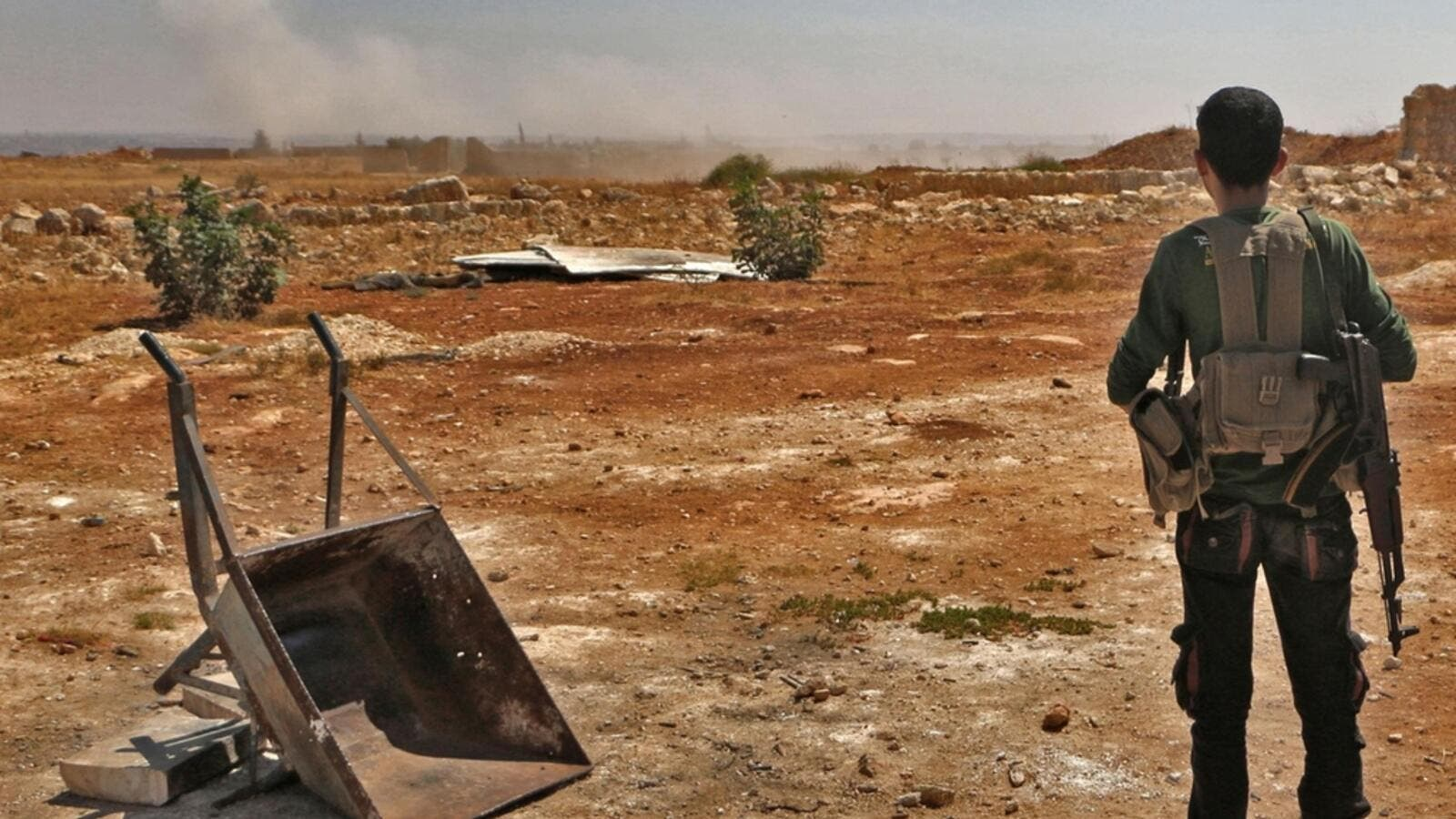 A Syrian rebel looks out to Idlib (AFP/FILE)
