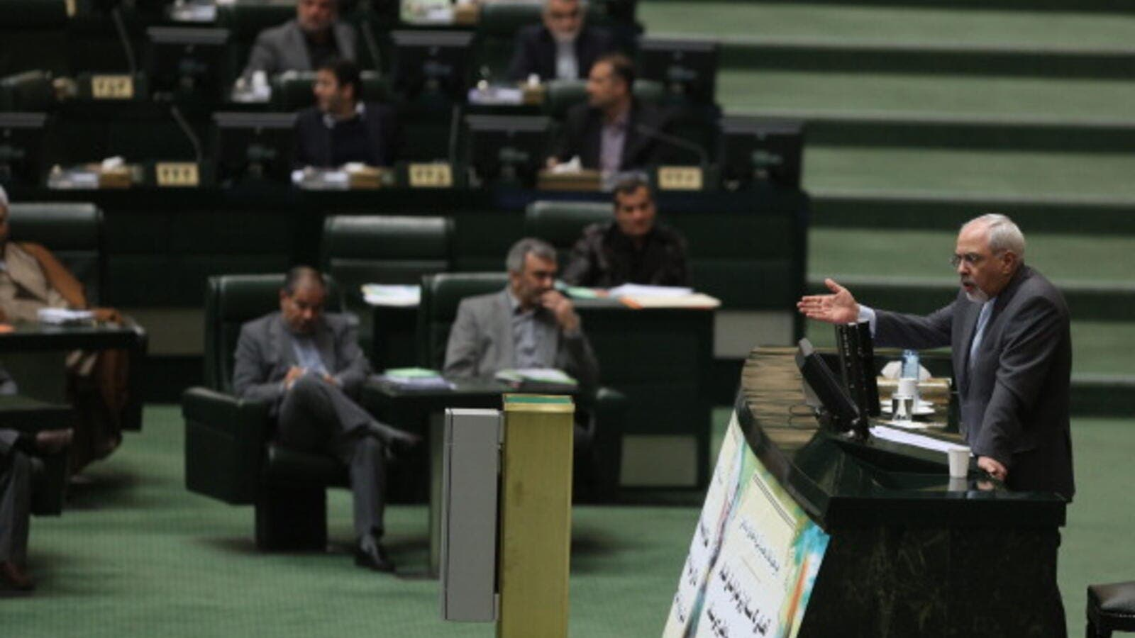 Iranian Foreign Minister Mohammad Javad Zarif addresses the parliament in Tehran on November 27, 2013. [Getty Images]