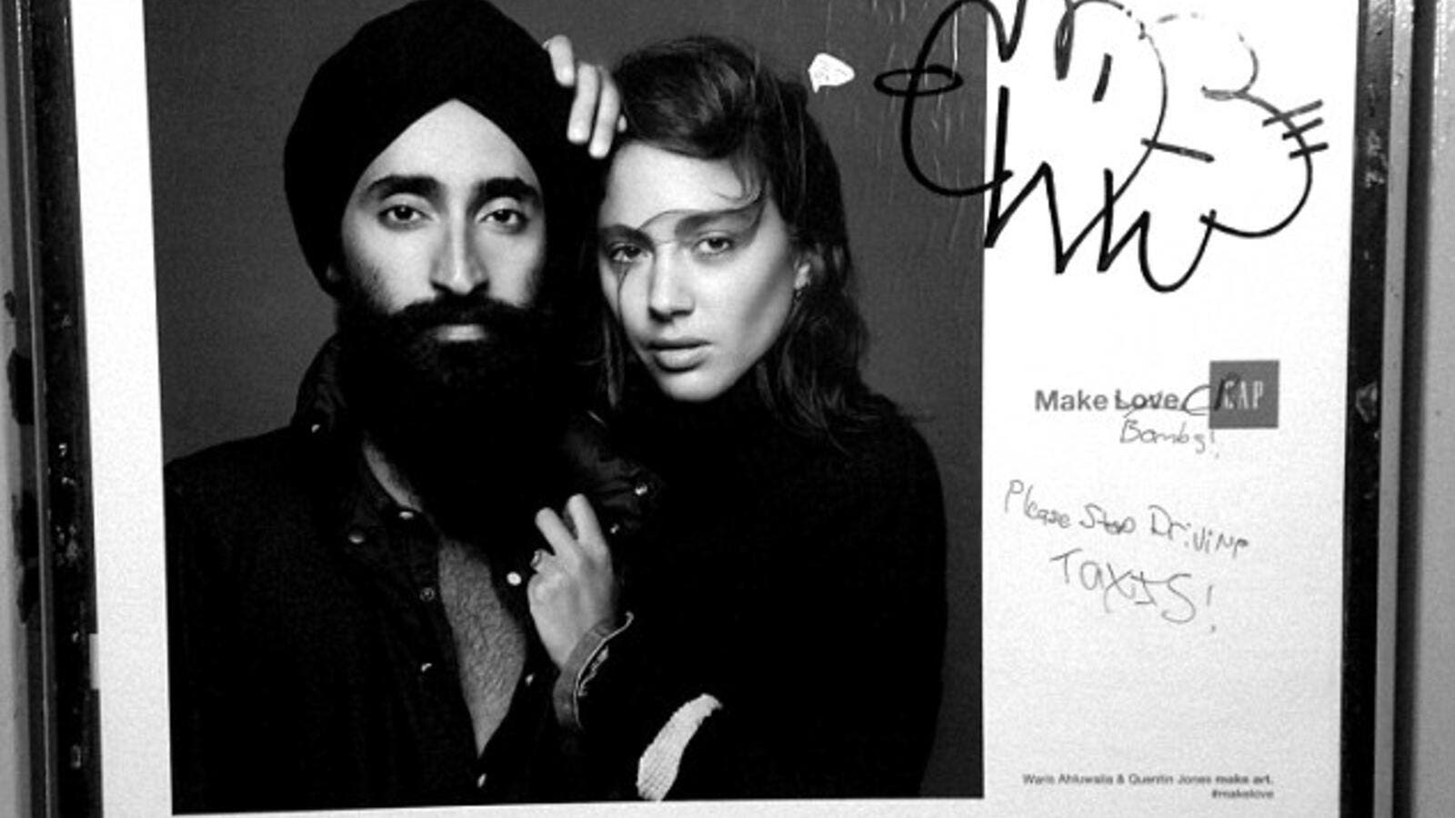 Anti-Muslim graffiti was found scribbled on a GAP ad featuring the Sikh jewelry designer and actor Waris Ahluwalia on a New York City subway platform. [Robert Gerhardt]