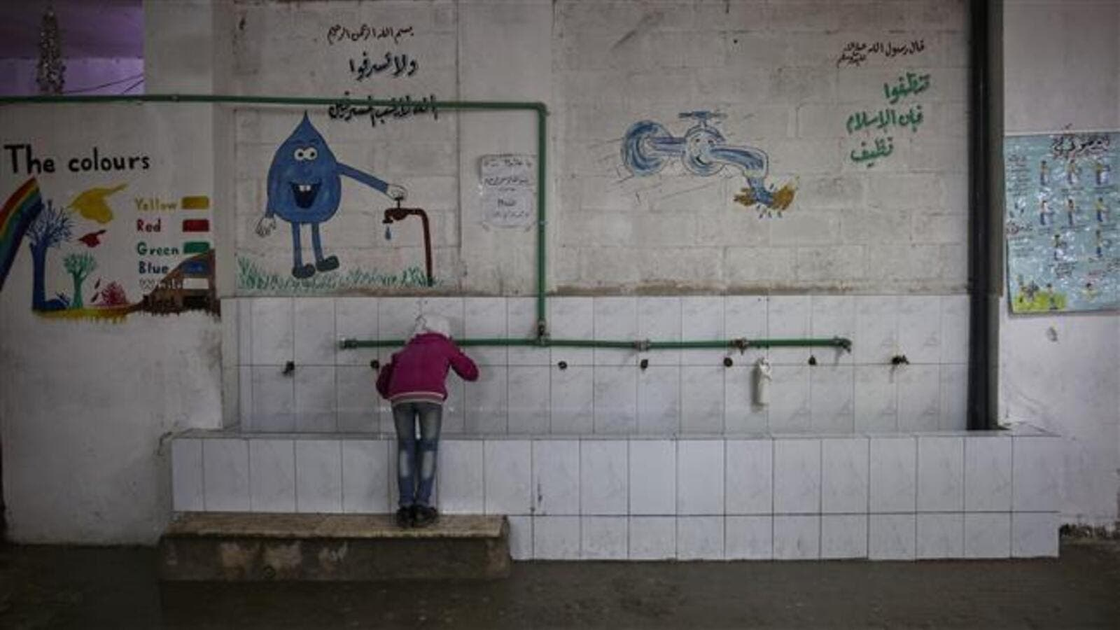 A Syrian girl drinks water at a school near Damascus on October 19, 2016. (AFP/File)