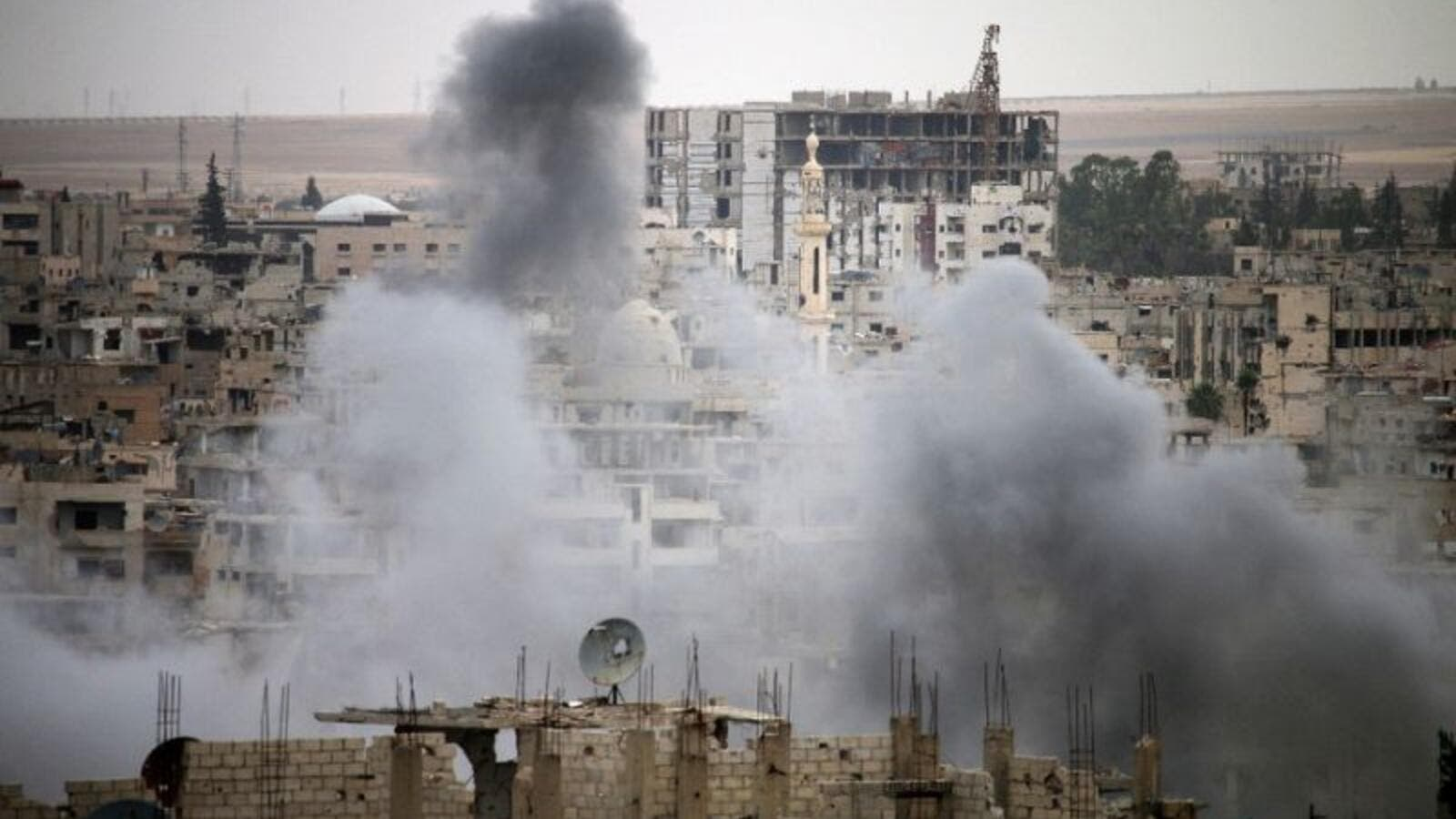 Smoke rises from buildings in a rebel-held neighbourhood of Daraa in southern Syria. (AFP/ File)
