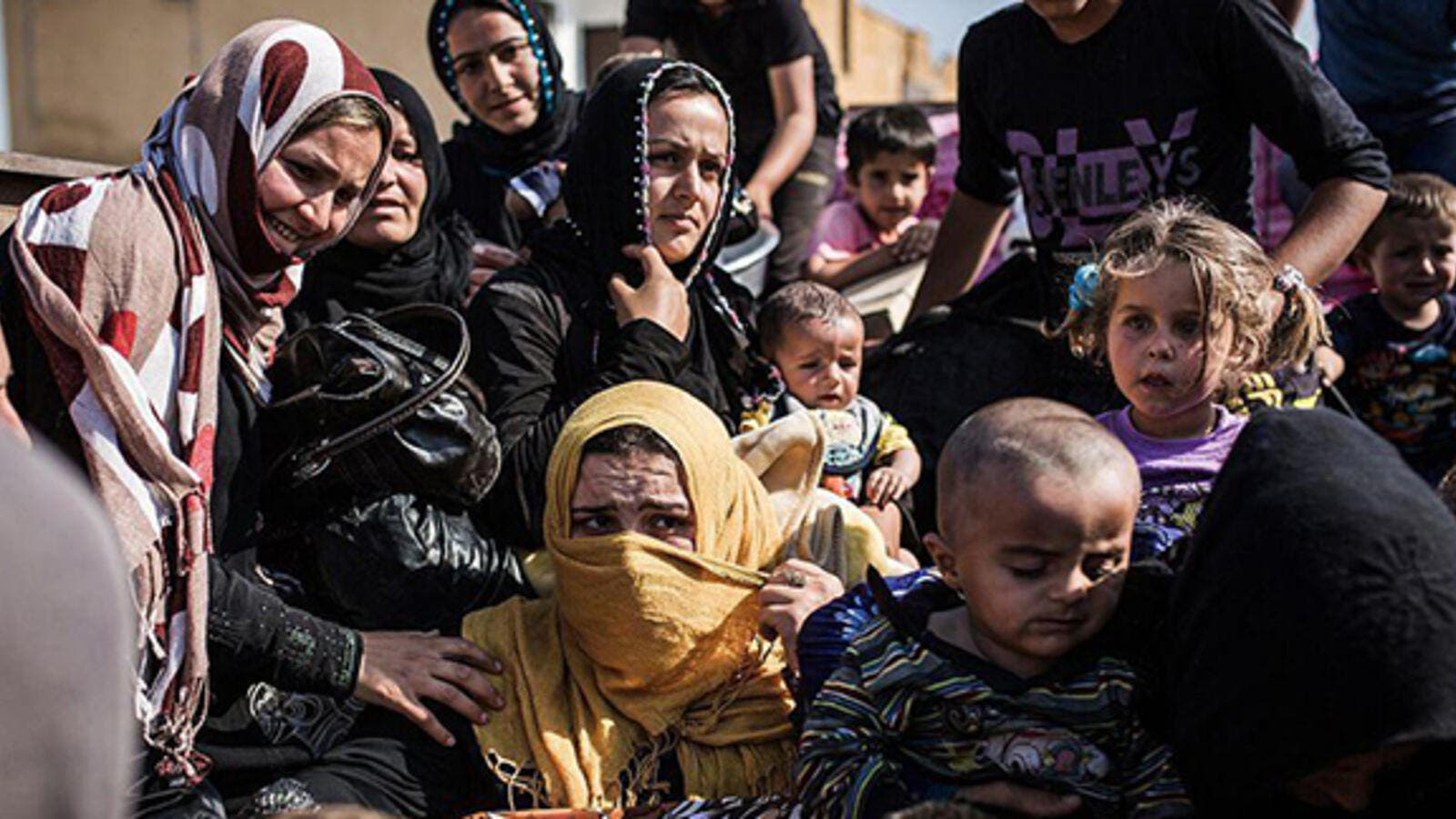 Syrian refugees from Raqqa governorate cross the Syria-Turkey border fleeing Isis in this file photo dated June 22 2015. (AFP)