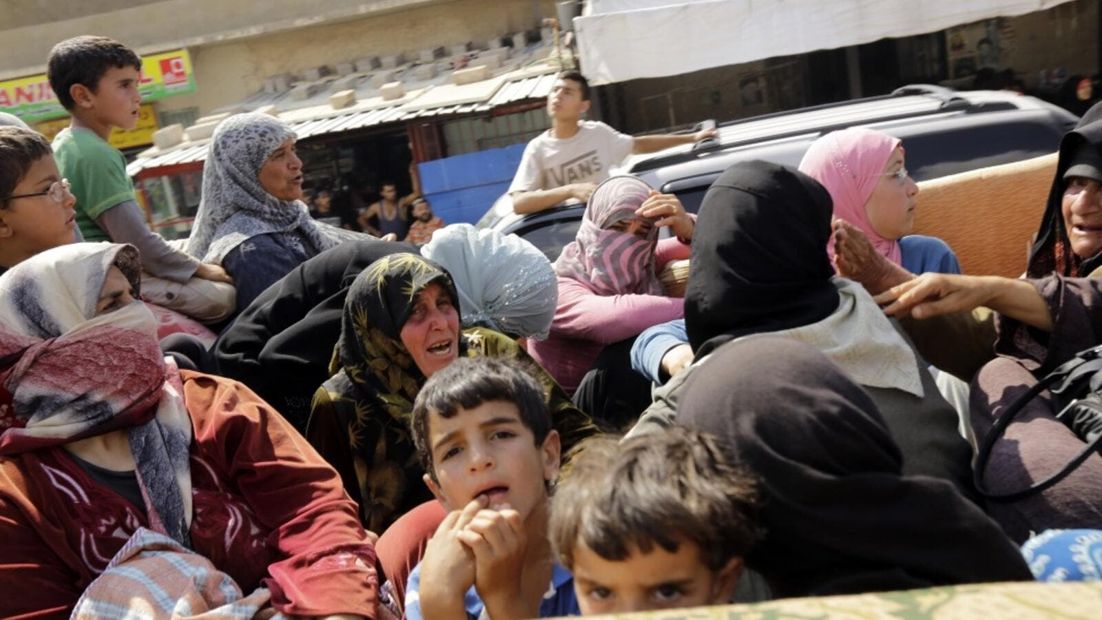 2,000 Syrian refugees reportedly stranded in Lebanon mountains. (AFP)
