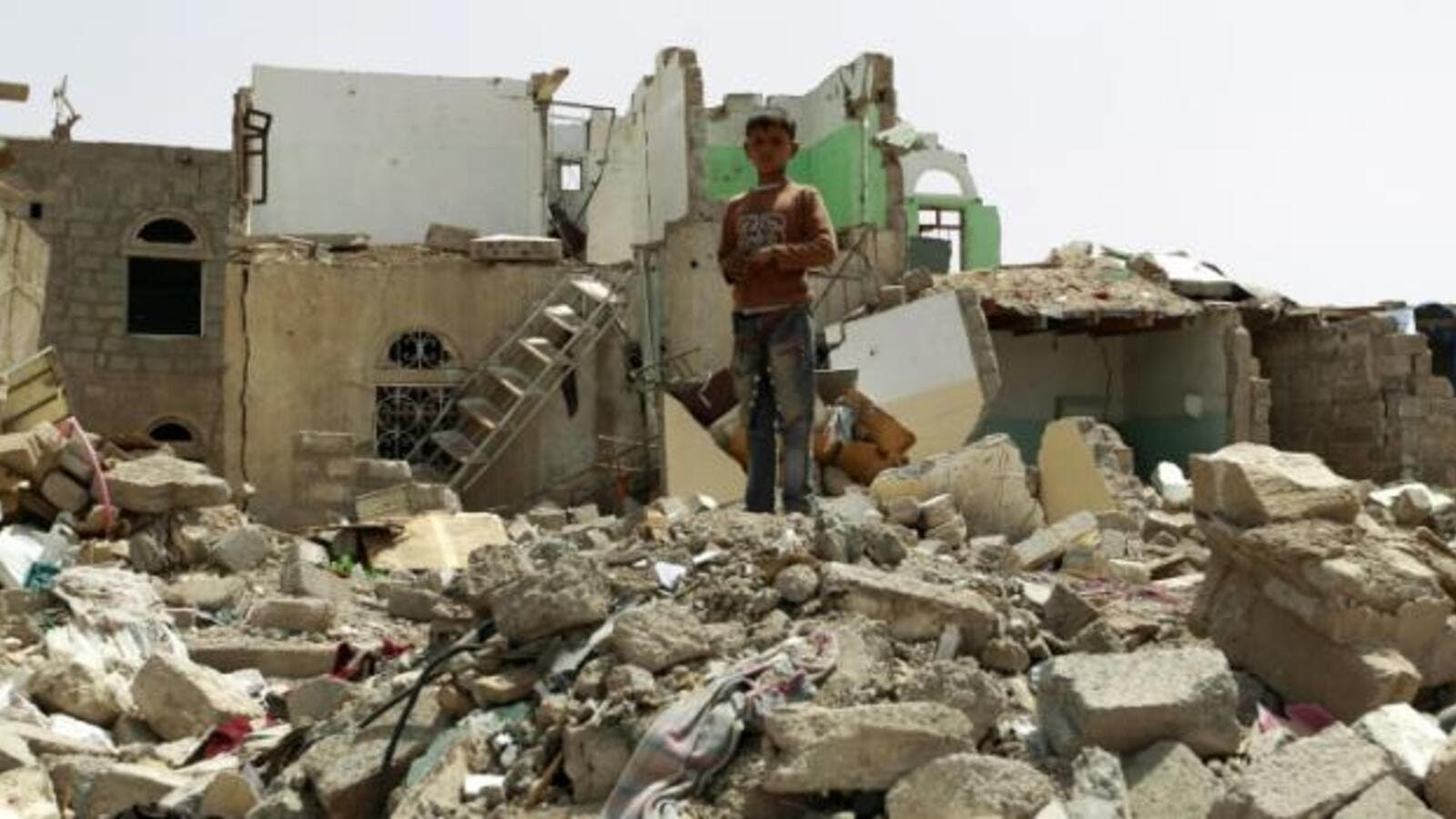 A child walks through the rubble after an airstrike in Taiz, Yemen. (AFP/File)
