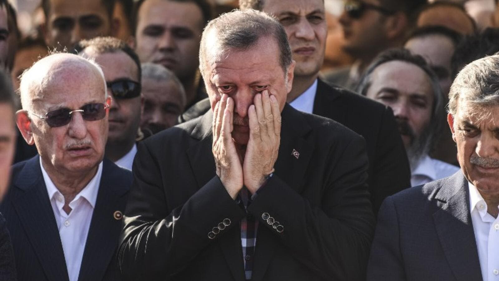 Turkey's President Recep Tayyip Erdogan reacts after attending the funeral of a victim of the coup attempt in Istanbul on July 17, 2016. (AFP/Bulent Kilic)