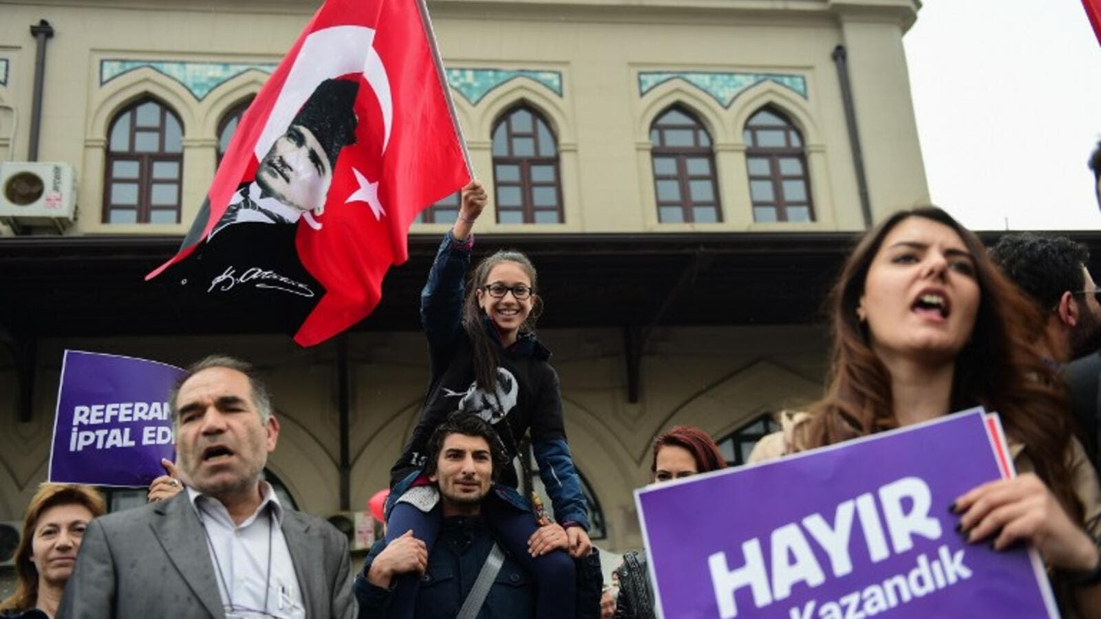 "Demonstrators hold a flag of Mustafa Kemal Ataturk, founder of modern Turkey and a placard reading ""No! This is just the beginning"" during a protest at the Kadikoy district in Istanbul on April 23, 2017 following the results in a nationwide referendum that will hugely enhance the president Recep Erdogan powers. (AFP/Yasin Akgul)"