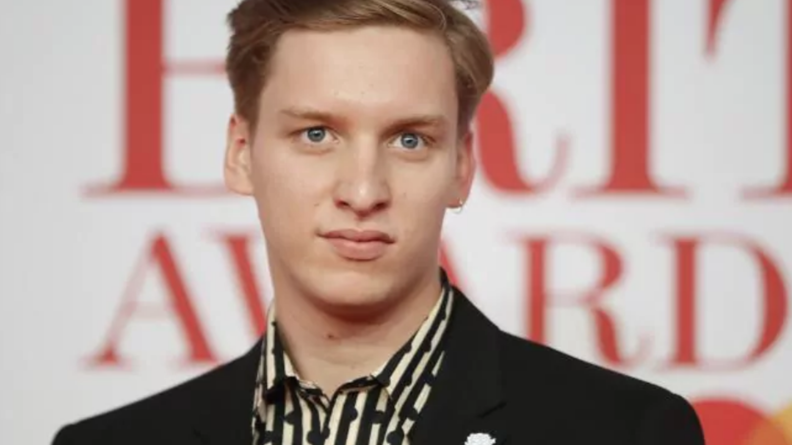 Singer-songwriter George Ezra says that he found it hard to adjust to being famous. /AFP