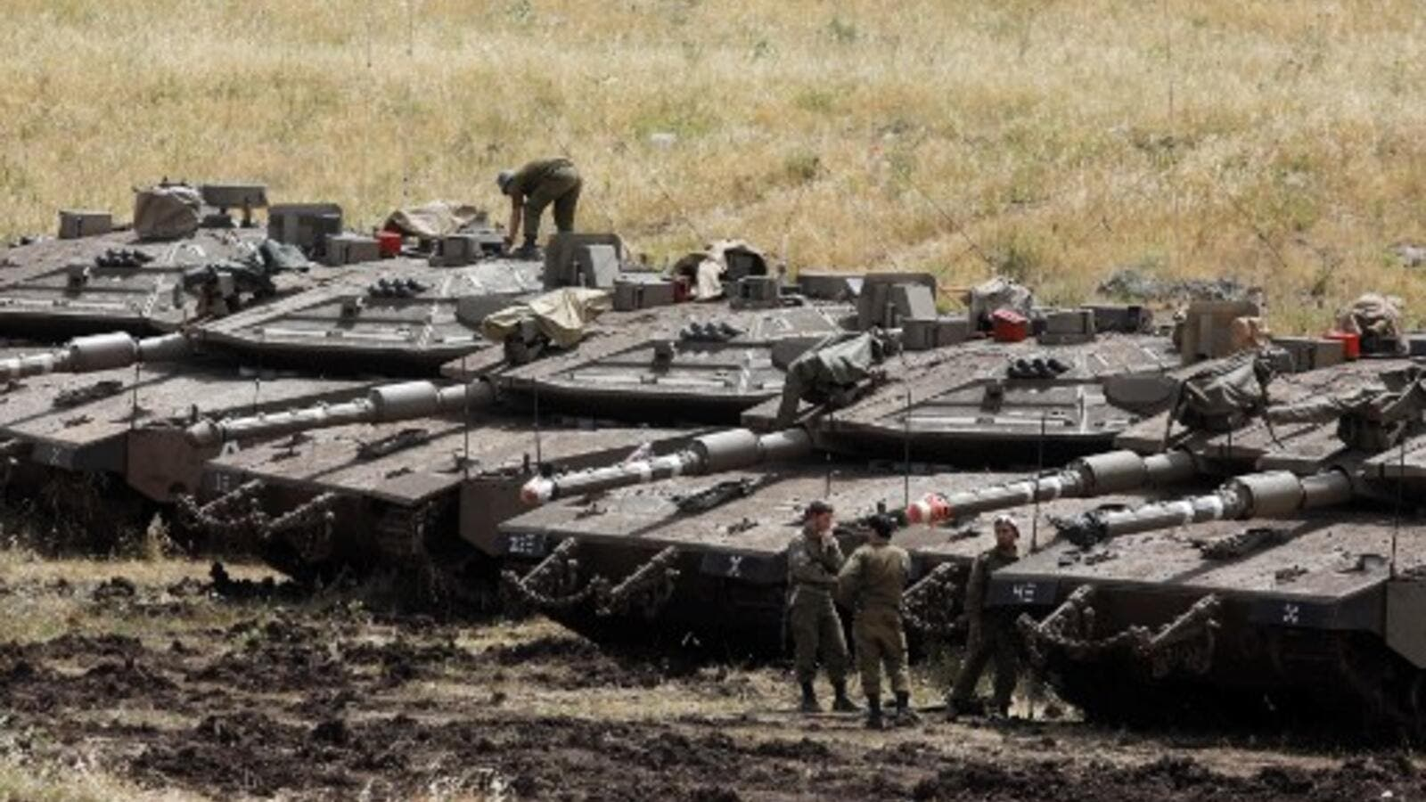 Israeli Merkava tanks are seen in a deployment area near the Syrian border in the Israel-annexed Golan Heights on May 10, 2018 (AFP)