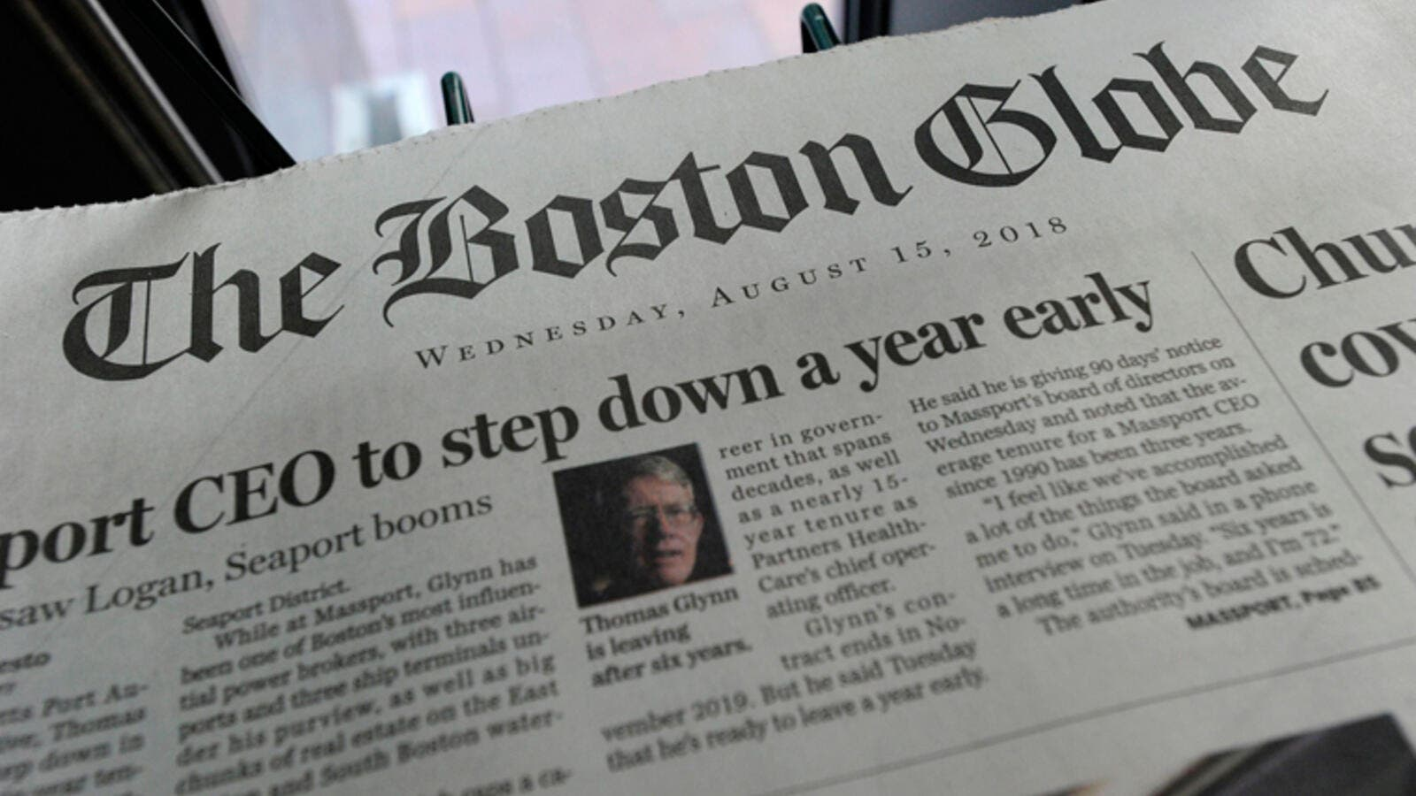 Copies of the Boston Globe are seen at a newspaper stand. (AFP/ File)