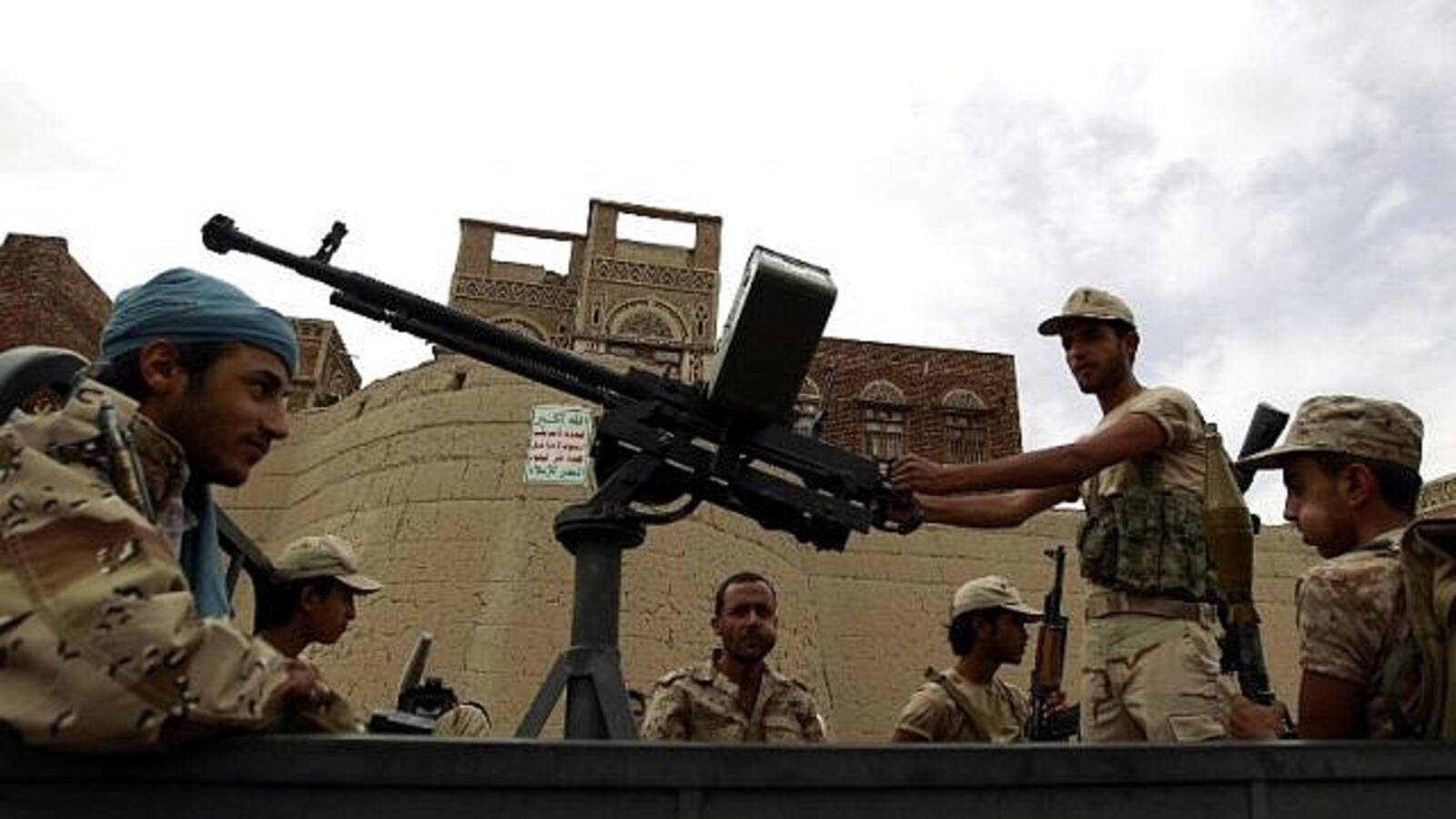 Armed Houthi rebels ride in the back of a truck during a rally in the capital Sanaa. (AFP/Mohammed Huwais)