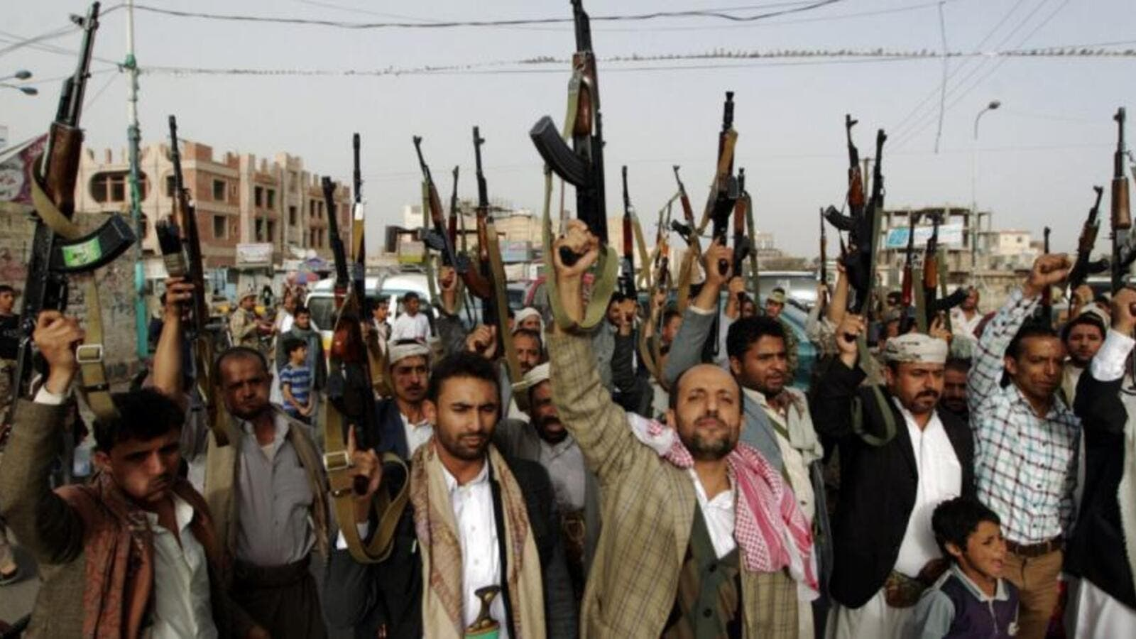 Houthi militants brandish their weapons during a rally in the Yemeni capital Sanaa. (AFP/ File Photo)