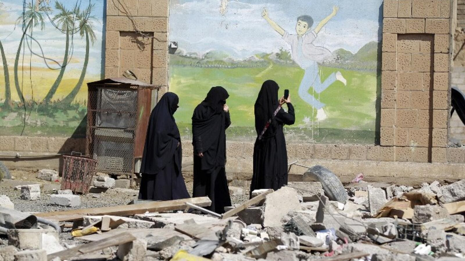 Yemeni women at the scene of an airstrike, March 18 (AFP)