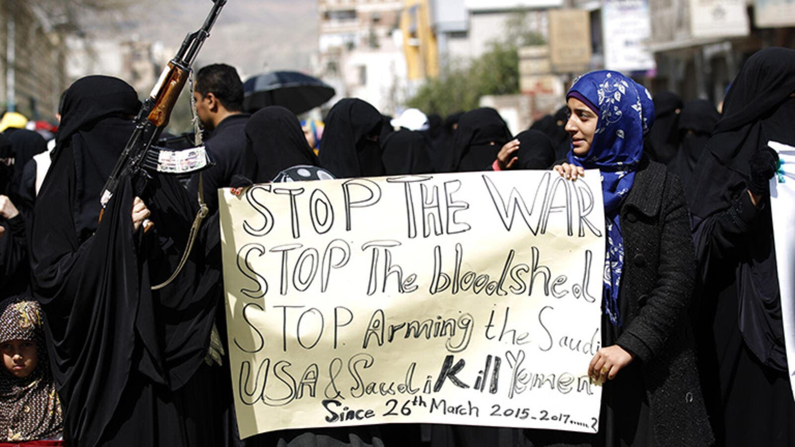 Yemeni women hold placards at a protest outside the Saudi embassy in Sanaa, Yemen, on March 18, 2017. (AFP/Mohammed Huwais)