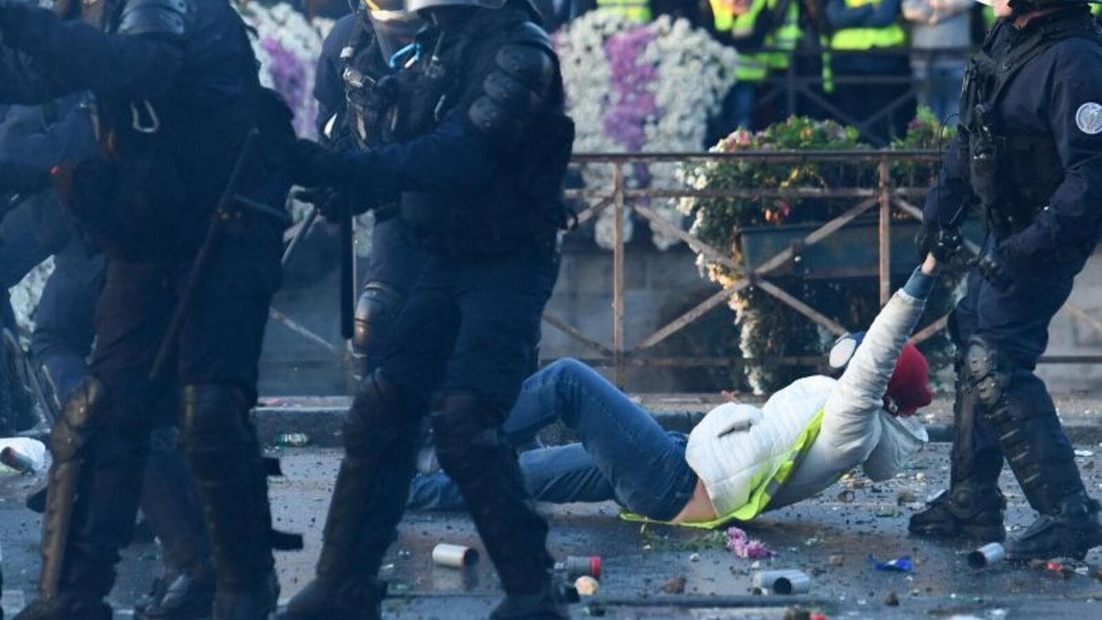 A policeman evacuates a demonstrator in Quimper, western France, during a nationwide day of protest. (AFP)