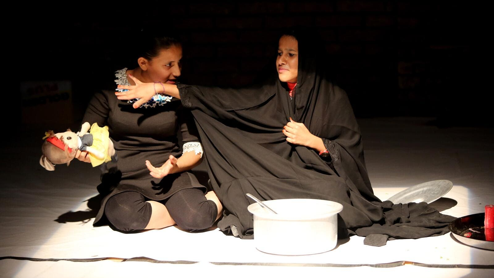 Teenage girls perform at a drama therapy workshop in Baghdad on October 1, 2015.  (AFP/File)