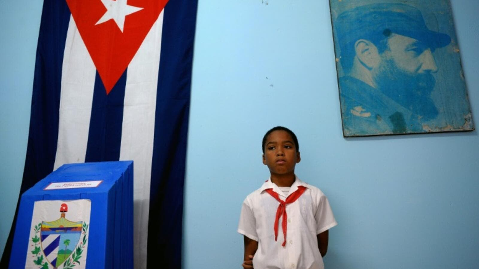 A schoolboy stands at a polling station in Havana during elections (AFP/File Photo)