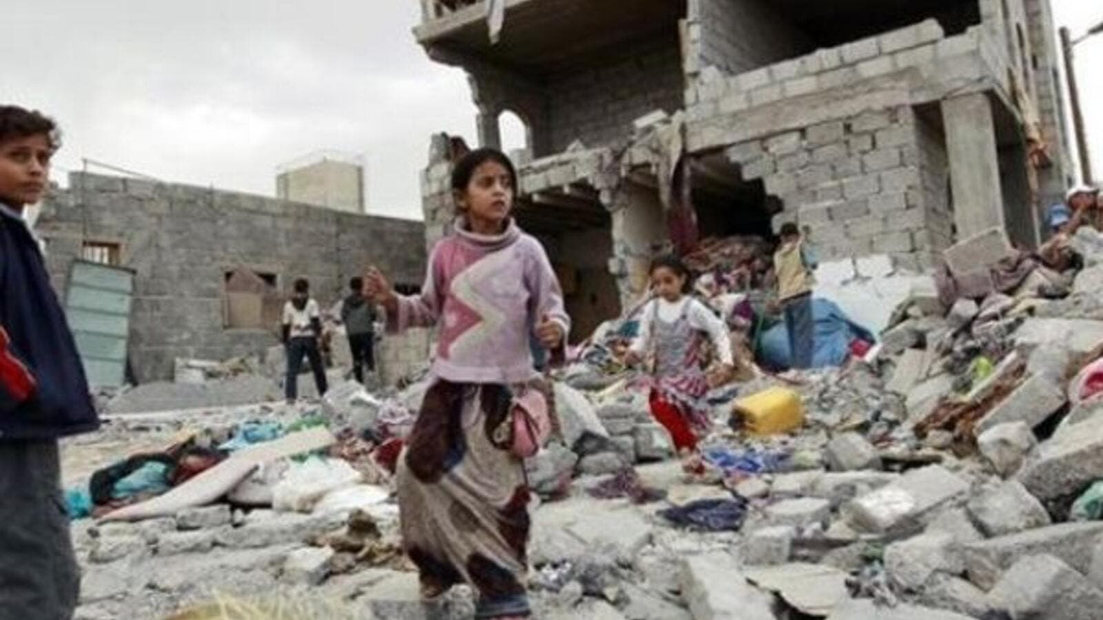 Children Stand on a bombed building in Yemen (AFP/File Photo)