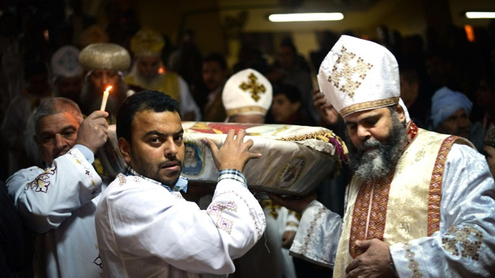 Egyptian Coptic Christian religious leaders celebrate Christmas in the monastery of Saint Samaan in Cairo on Jan. 6, 2015 (AFP)