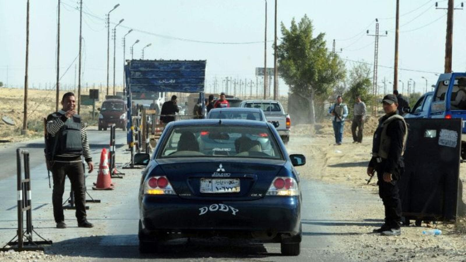 Egyptian police inspect cars at a checkpoint in North Sinai. (AFP/File)