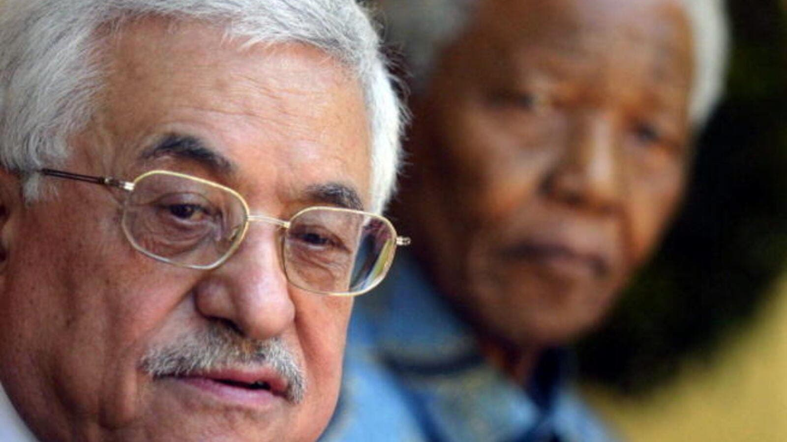 Palestinian Authority President Mahmoud Abbas and the former South African President Nelson Mandela pose at Mandela's house inJohannesburg 01 April 2006.Abbas said he considered Mandela as the father of all liberation movements. [Getty Images]