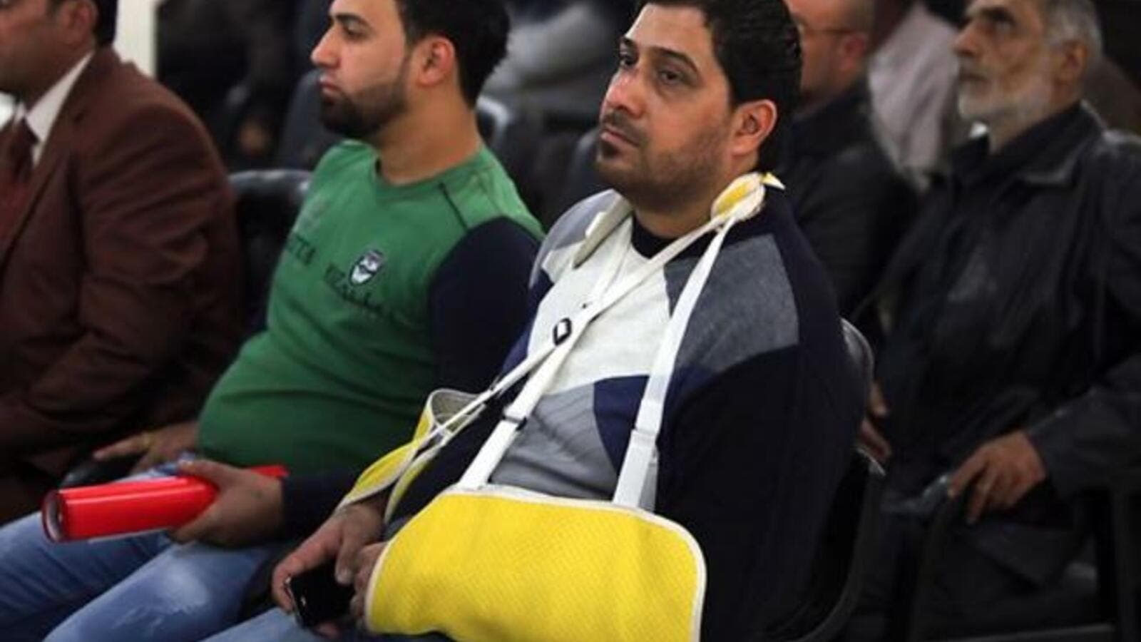 An Iraqi cafe owner injured in an bomb attack attends a seminar for owners. [resources1]