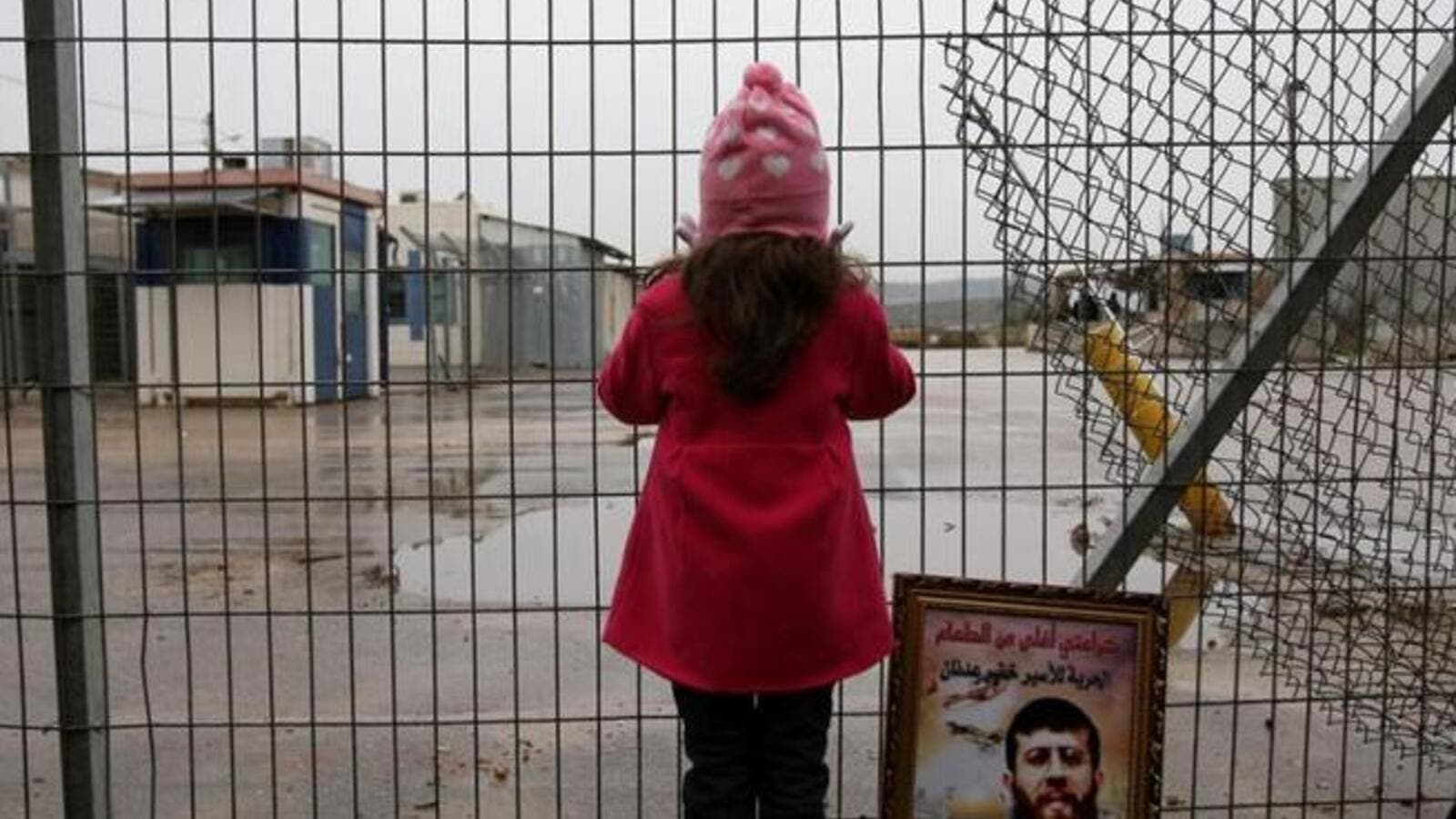 A Palestinian girl stands outside an Israeli jail. (AFP/File Photo)