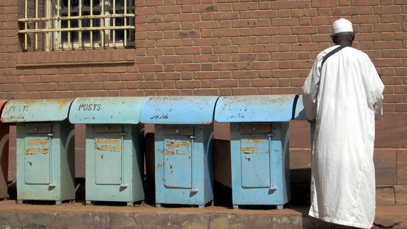 A man sends a letter at a post office in Khartoum, Sudan.  (Flickr Creative Commons/David Stanley)