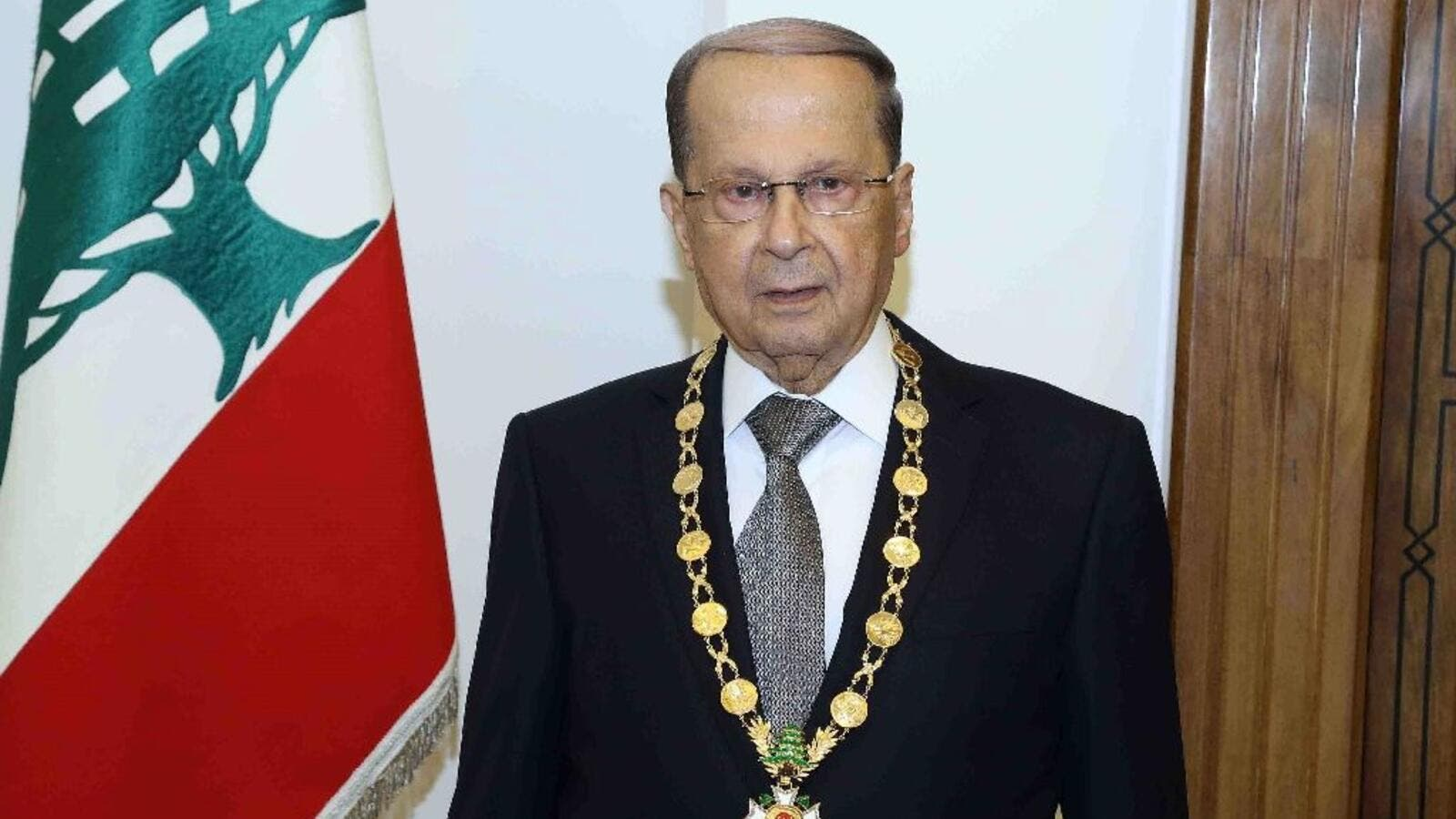 Lebanese President Michel Aoun posing with the presidential medal at the presidential palace of Baabda, east of Beirut on October 31, 2016. (AFP/File)