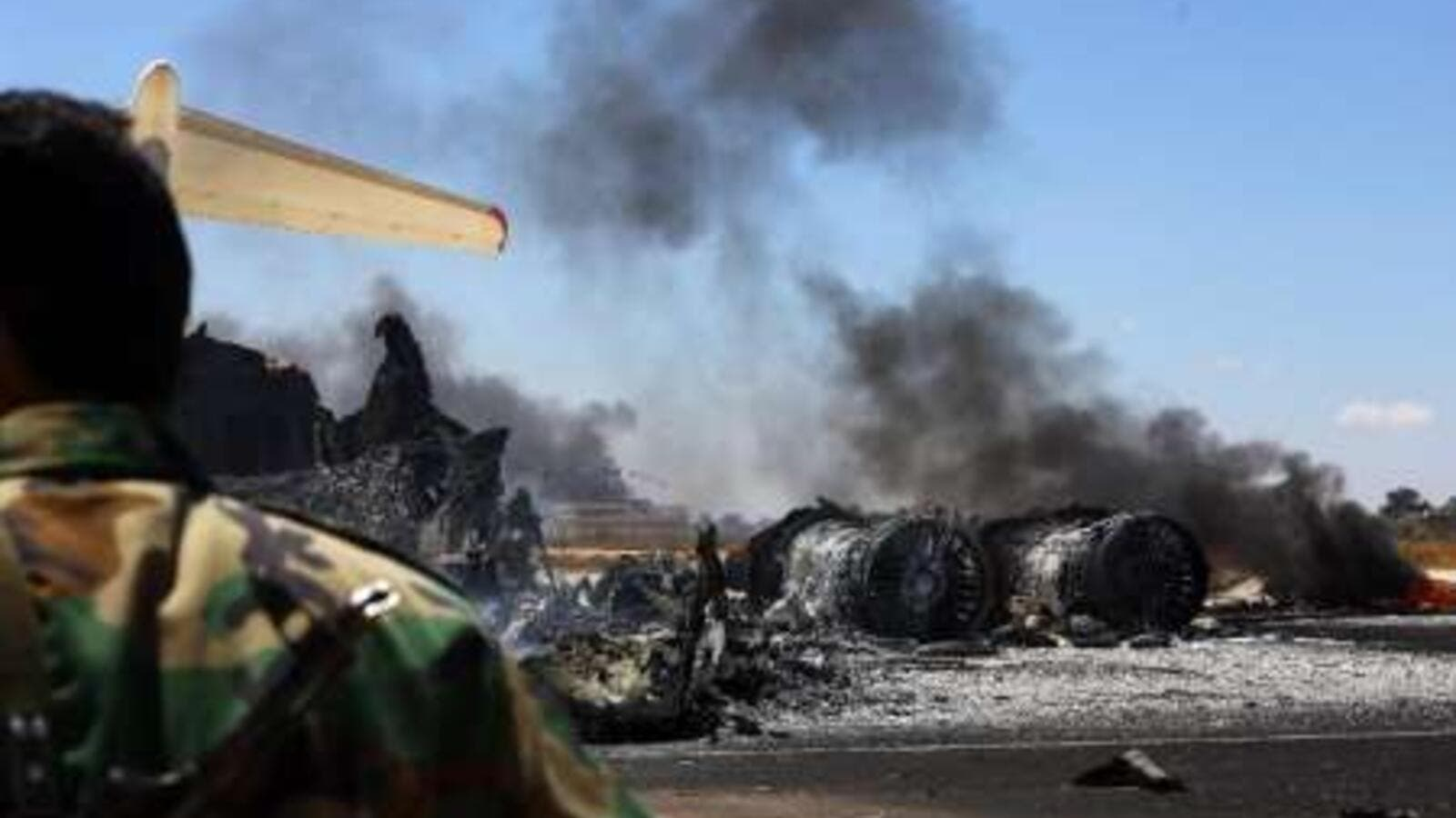 The remains of a burnt airplane seen at the Tripoli International Airport in Libya on July 16, 2014. (AFP/Mahmud Turkia)