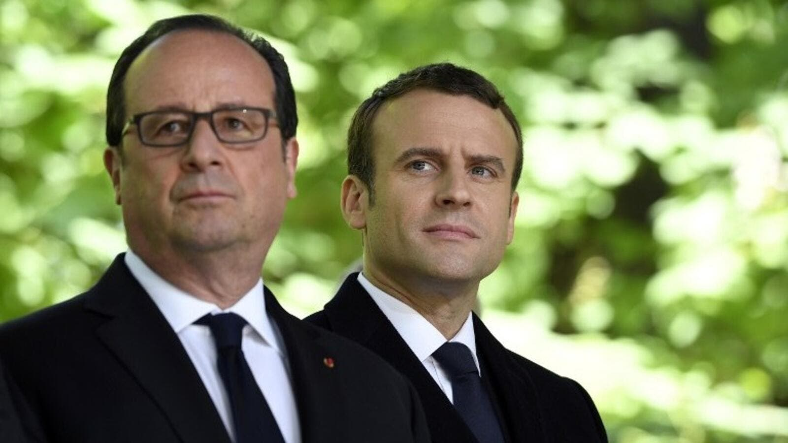 Then French President Francois Hollande (L) and French President-elect Emmanuel Macron at a special ceremony at the Jardin du Luxembourg, on May 10, 2017. (AFP/ Eric Feferberg)