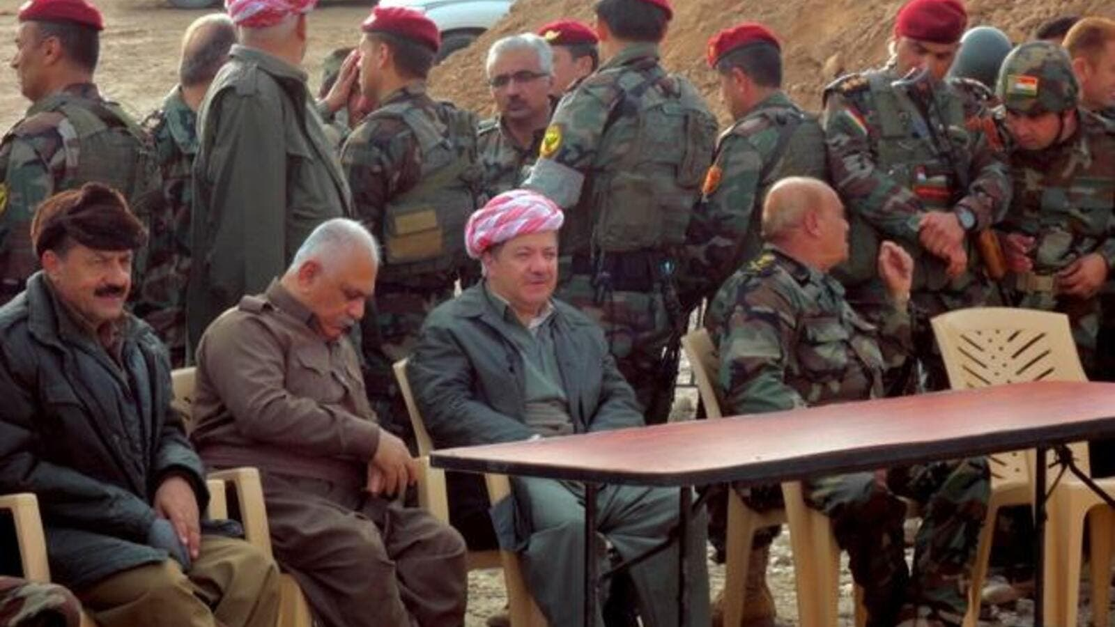 Massud Barzani, the president of Iraq's autonomous Kurdistan region (C-bottom) sits amidst Kurdish peshmerga security forces during a visit to the disputed north Iraq province of Kirkuk. (AFP PHOTO/MARWAN IBRAHIM)