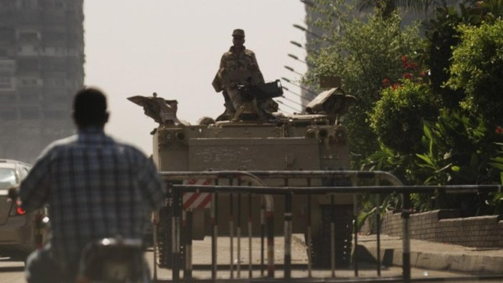 An Egyptian soldier keeps watch from the top of an army armoured personnel carrier at the entrance of Tahrir Square on August 18, 2013 in Cairo. (AFP)