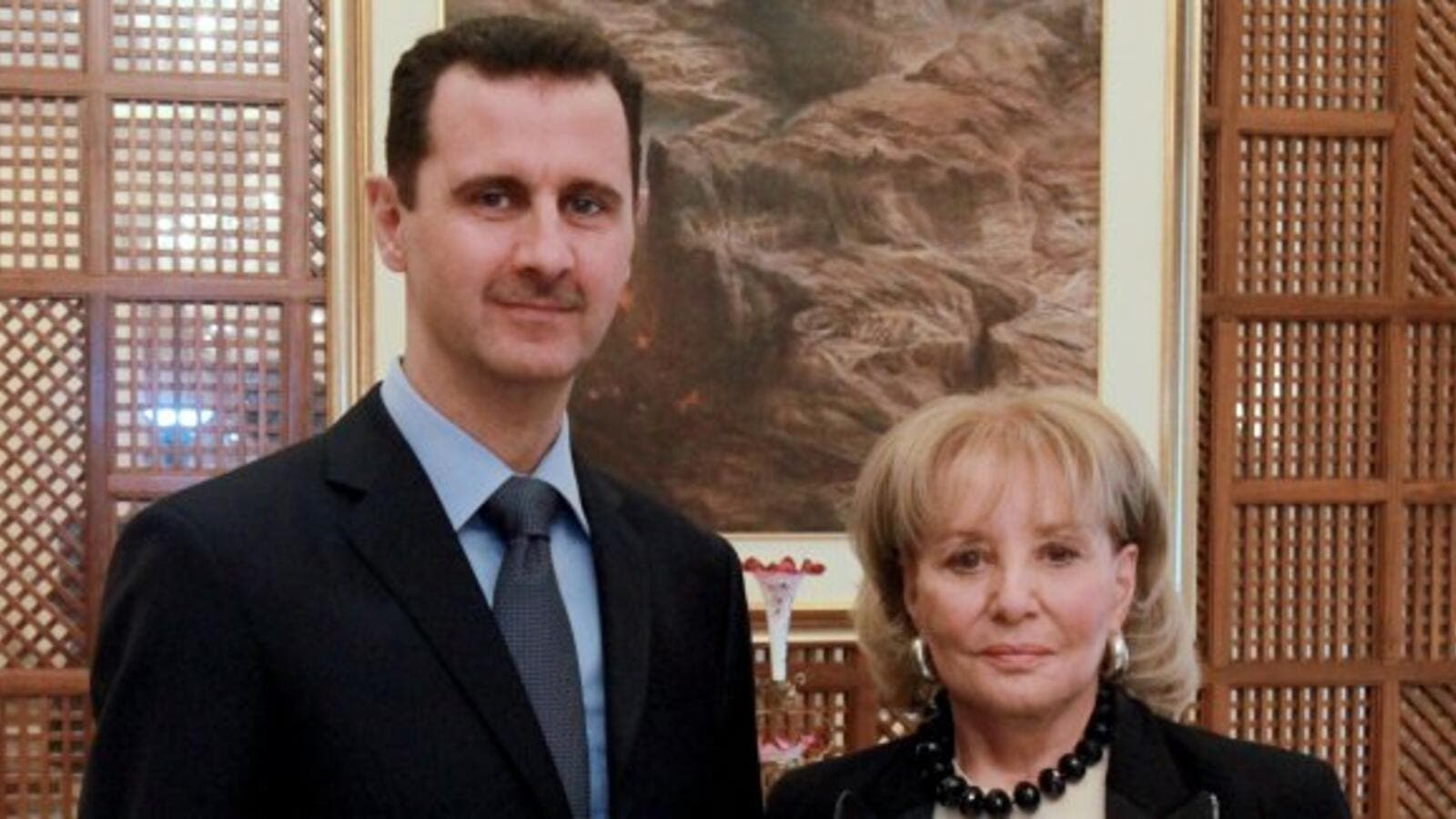 "Bashar Al-Assad pictured with a somber Barbara Walters. (Image courtesy of ""mail.com"")"