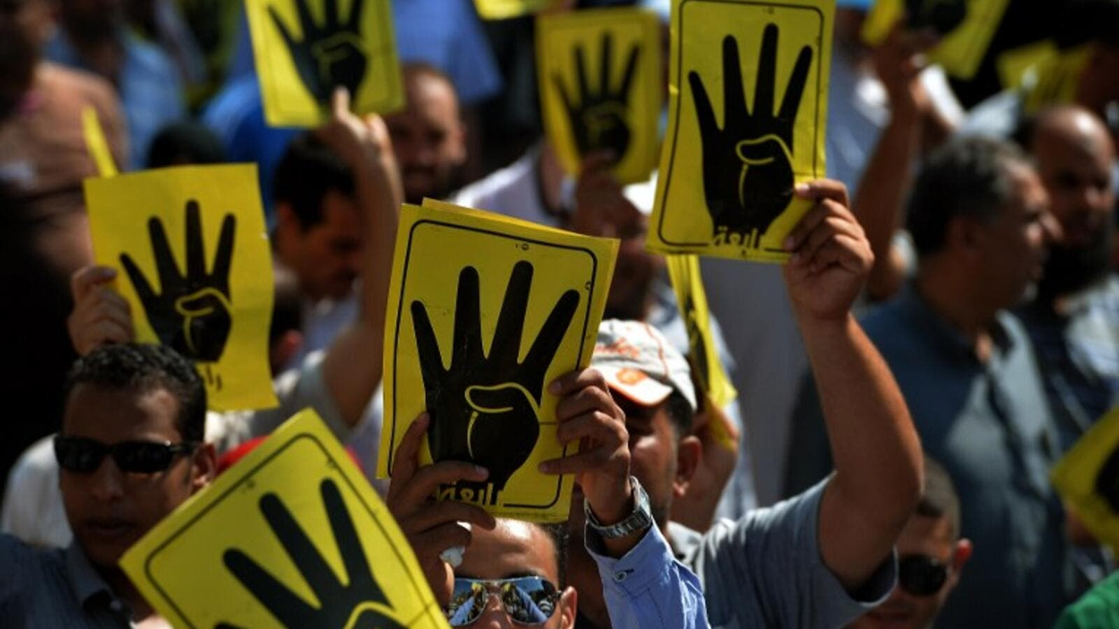 Supporters of ousted Islamist president Mohamed Morsi wave the 'rabaa' sign of four fingers in a show of solidarity with the Muslim Brotherhood movement in Cairo. (AFP/File)