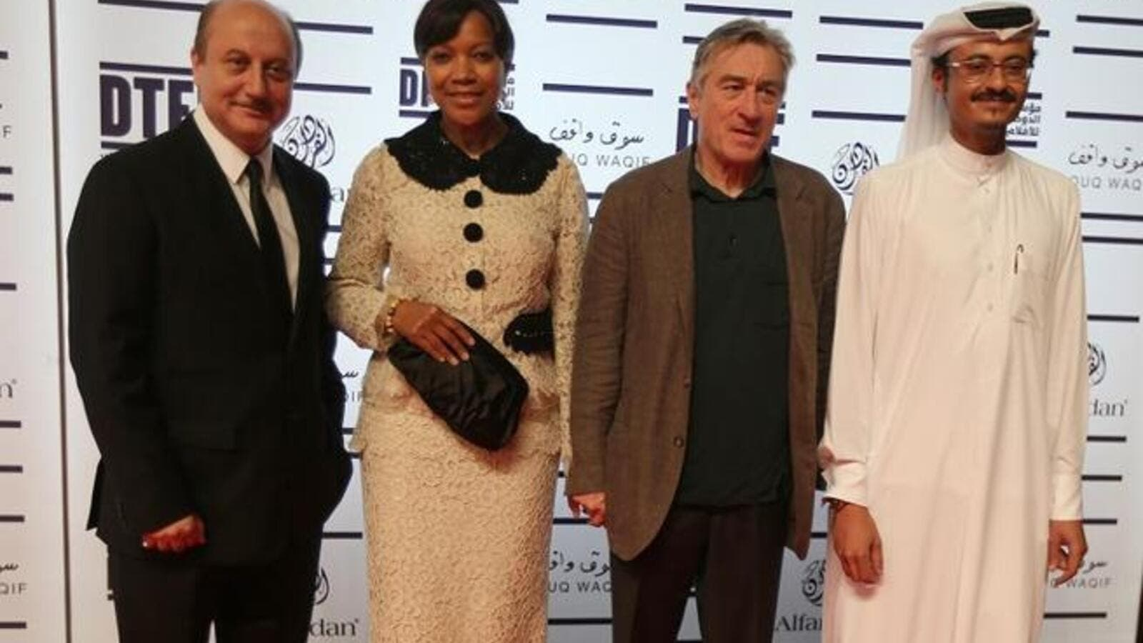 US actor Robert De Niro (2nd L) founder of New York's Tribeca Film Festival, poses for a photograph along side his wife Grace Hightower De Niro and Indian actor Anupam Kher (L) and Doha Film Institute CEO Abdulaziz Bin Khalid Al-Khater (R) at the Doha Tribeca Film Festival in the Qatari capital. AFP