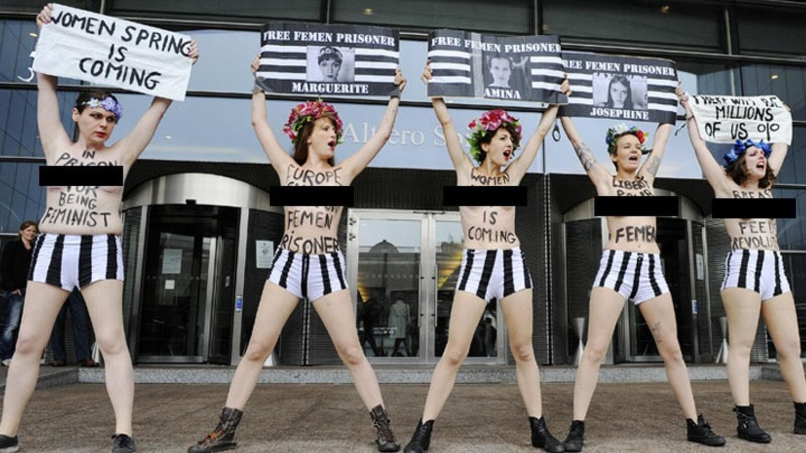 Members of the women's topless protest group Femen hold banners during a protest in front of the European Union Parliament in Brussels, to support a detained Tunisian activist and three European activists detained in Tunis. AFP photo