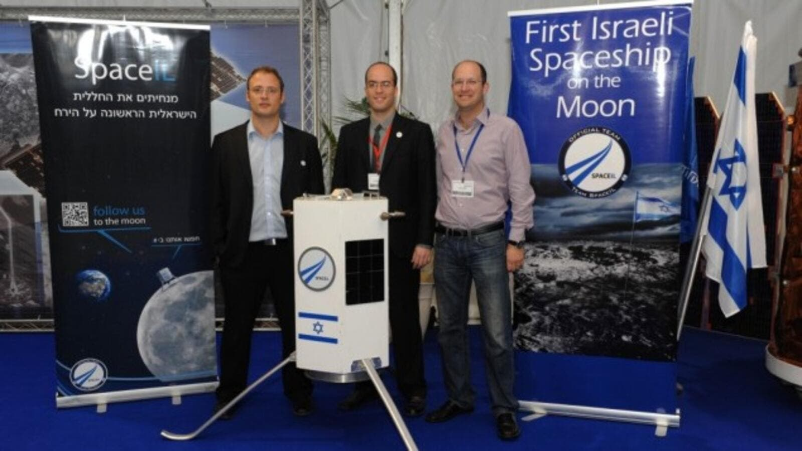 Three of SpaceIL's founders -- Yariv Bash, Yonatan Winetraub, and Kfir Damari -- with a model of the spacecraft they propose to send to the moon (photo: Times of Israel / Alon Hadar)
