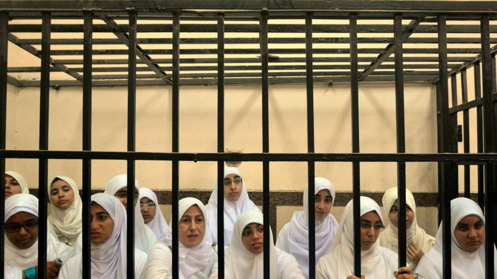 Fourteen women and seven girls were sentenced to heavy jail terms due to their alleged ties to the Muslim Brotherhood and participation in a violent October protest (AP)