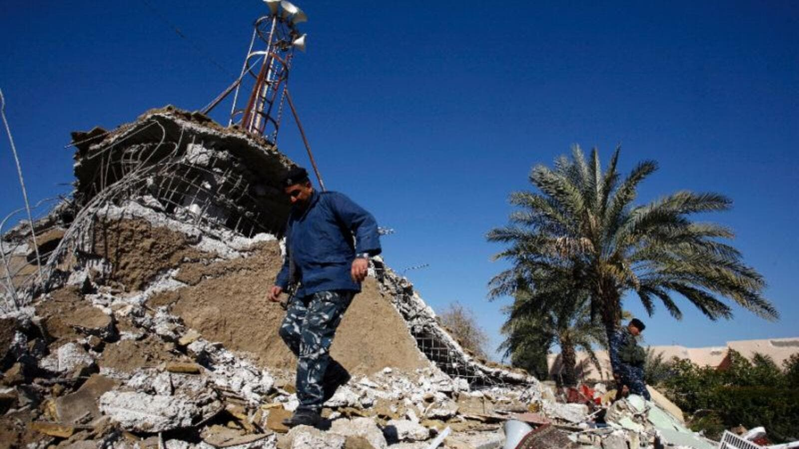 A man surveys the debris of the al-Fateh mosque, bombed by militants in Iraq earlier this year. (AFP/File)