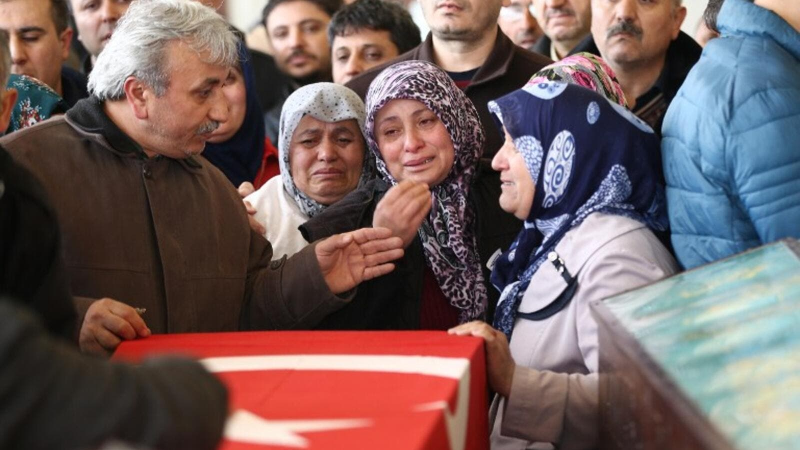 Family members and relatives of a victim mourn in a mosque in Ankara, on March 14, 2016, a day after a suicide car bomb ripped through a busy square in central Ankara killing 37 people and wounding 125, officials said. (AFP/Adem Altan)